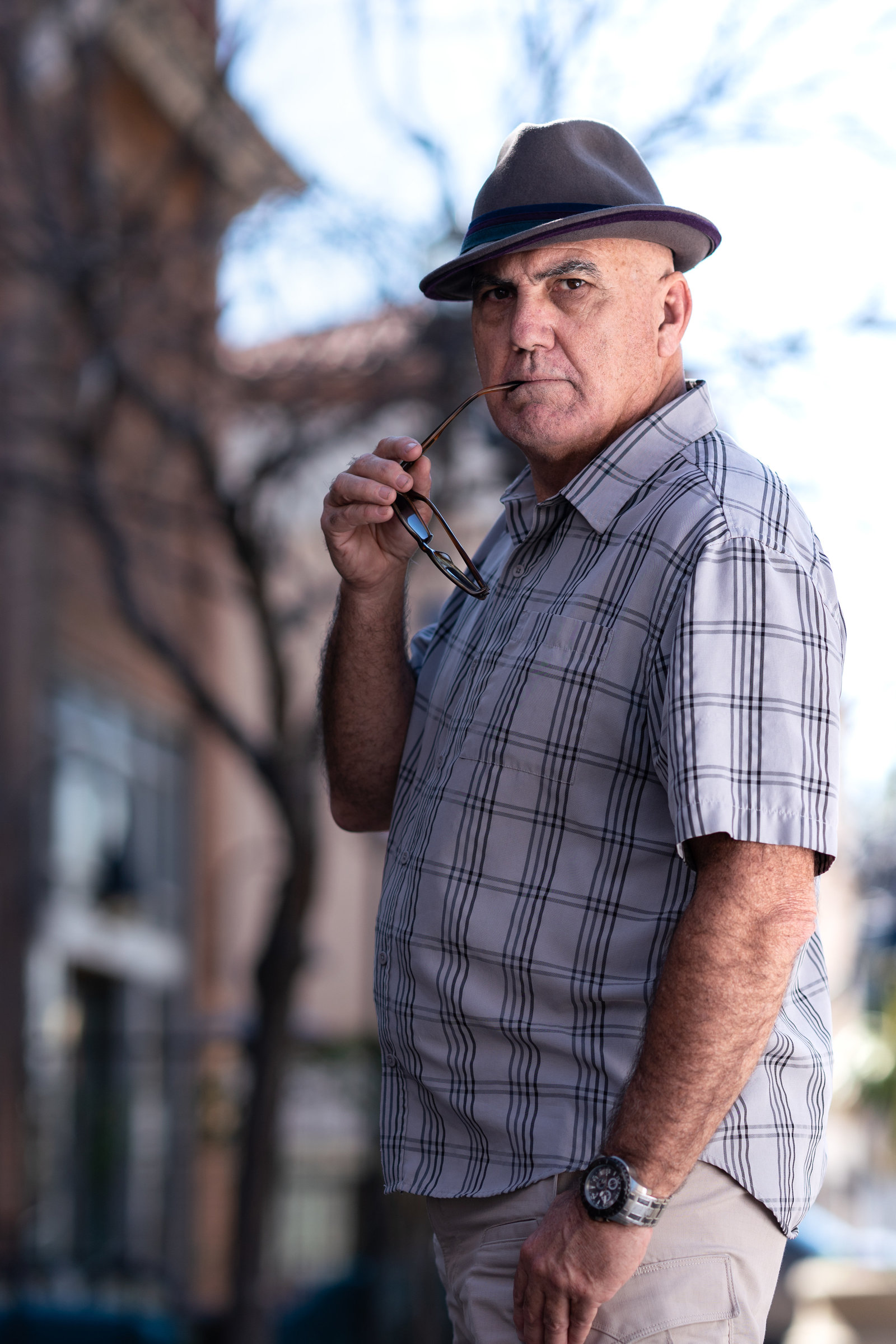 Traditional Portrait of man in fedora natural light
