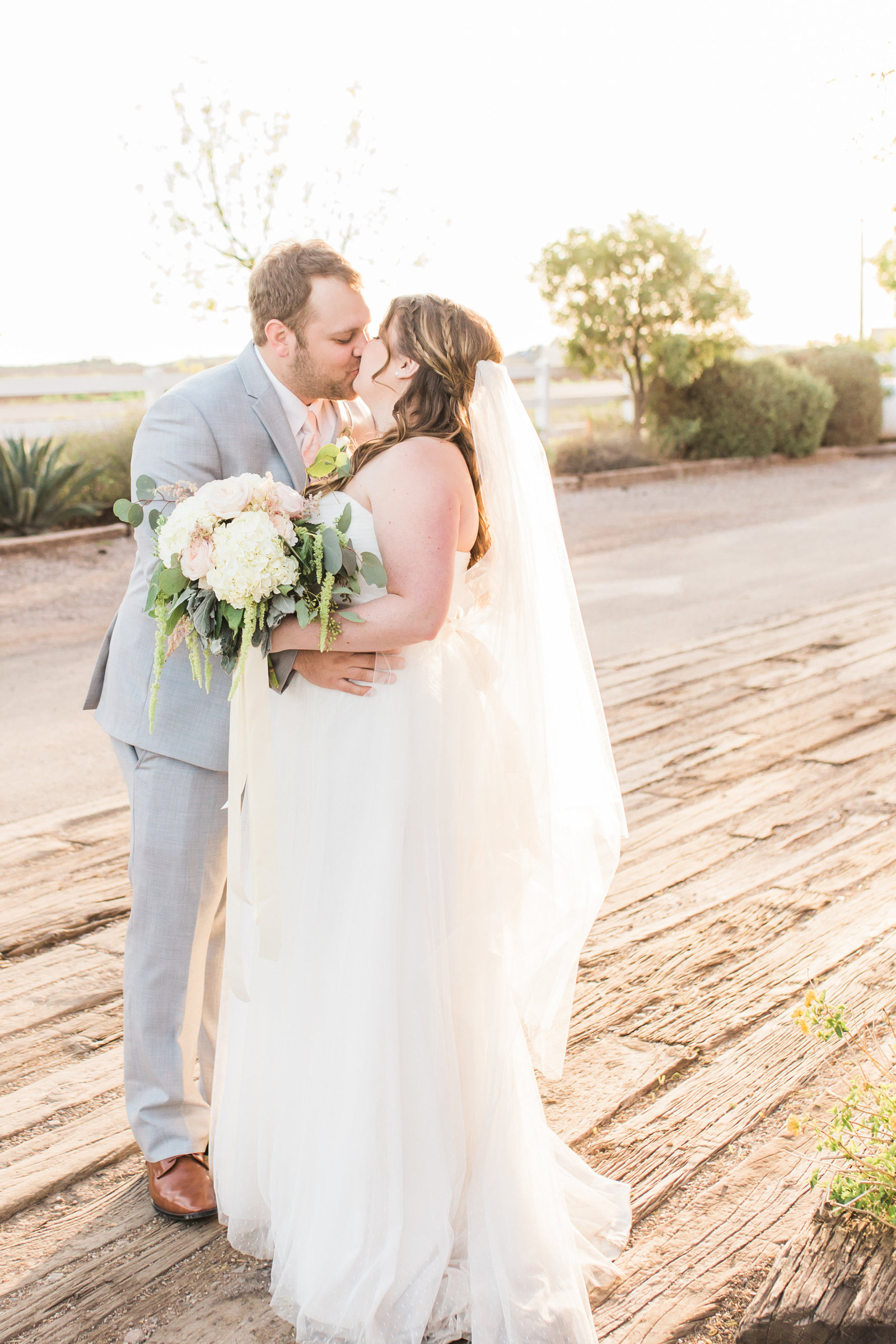 Florence Windmill Winery Rustic Elegant Wedding Photo with Bride and Groom Kissing | Tucson Wedding Photographer | West End Photography