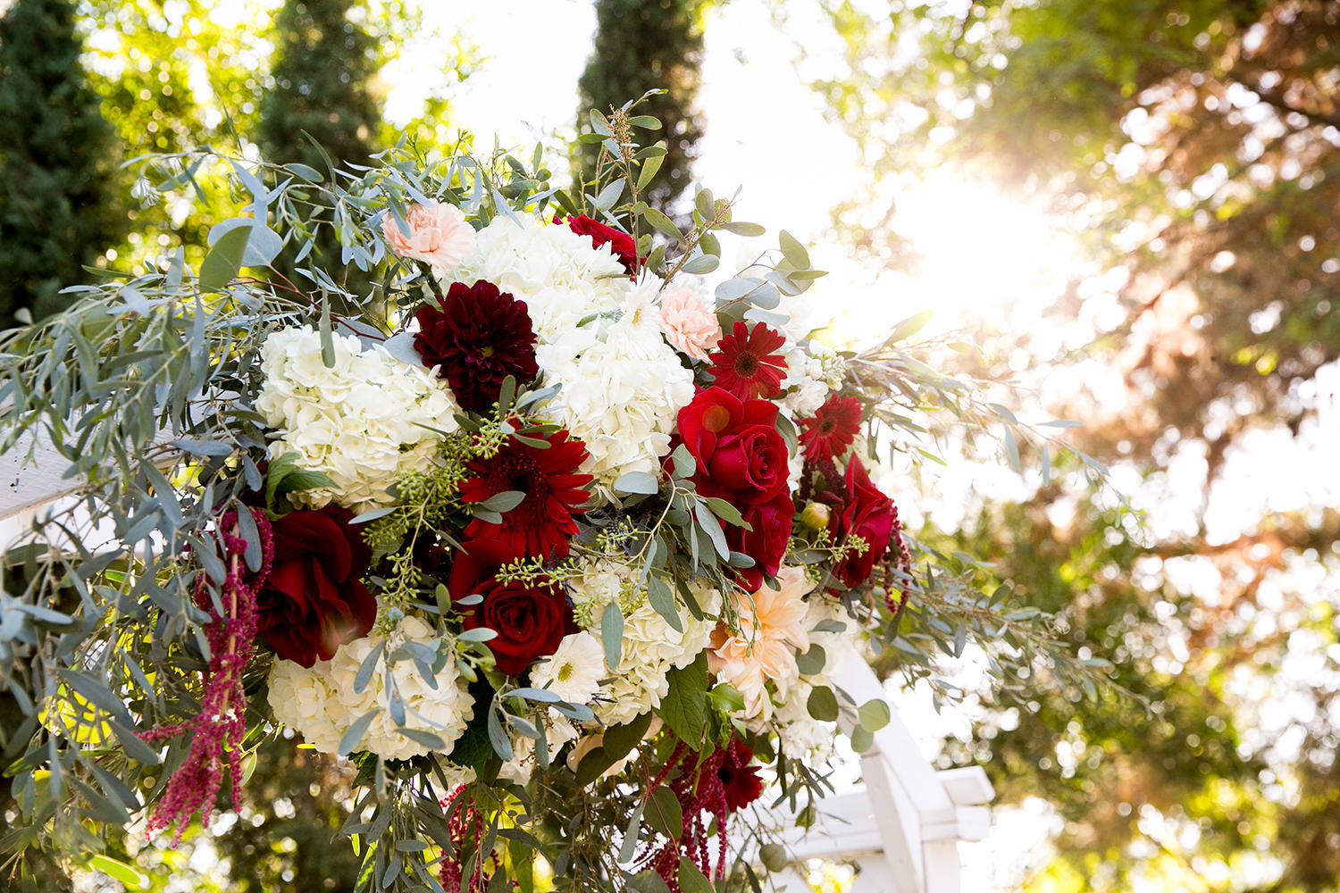 stunning ceremony space at carlton oaks red and white flower arch