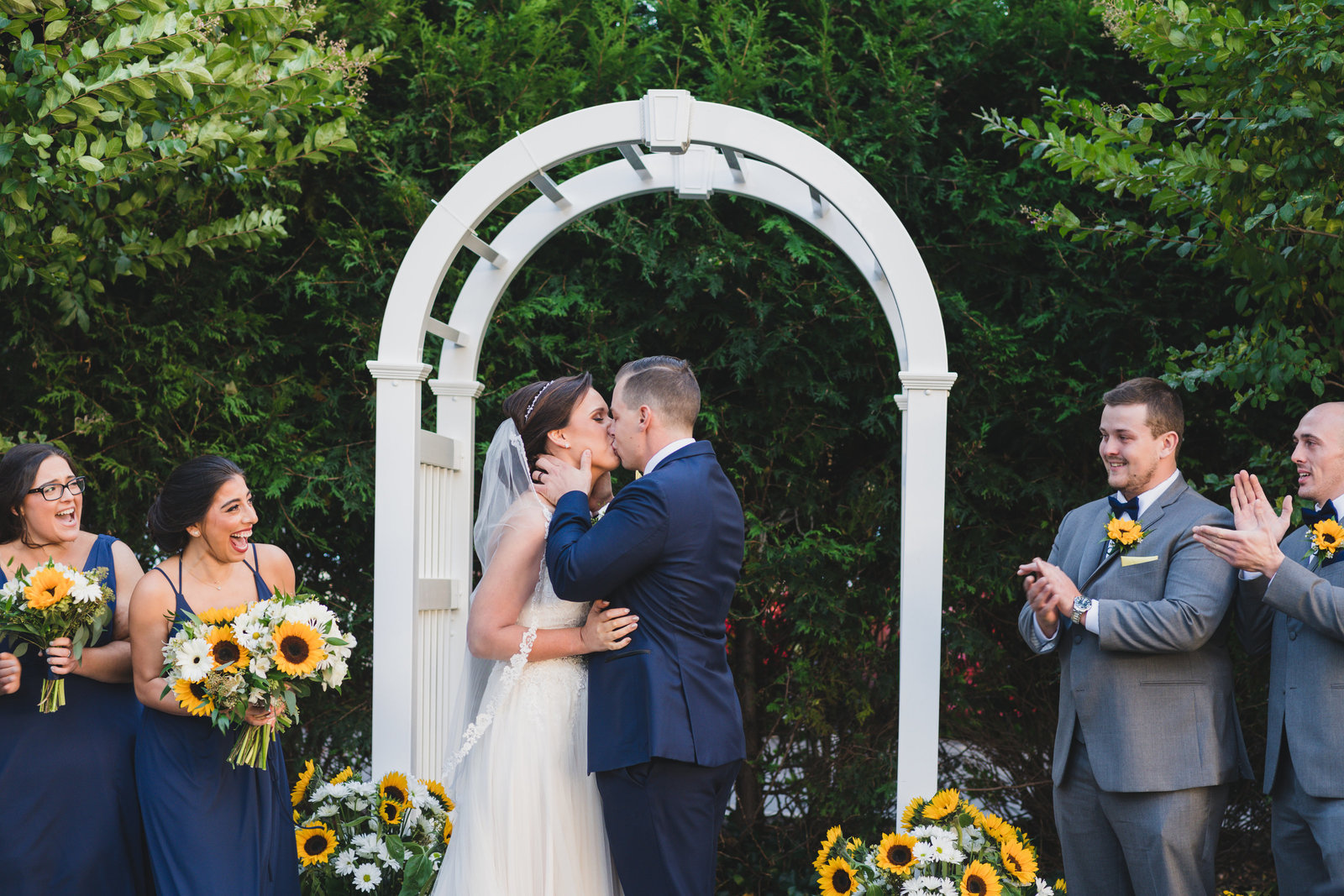 photo of bride and groom kissing after ceremony wedding at Three Village Inn