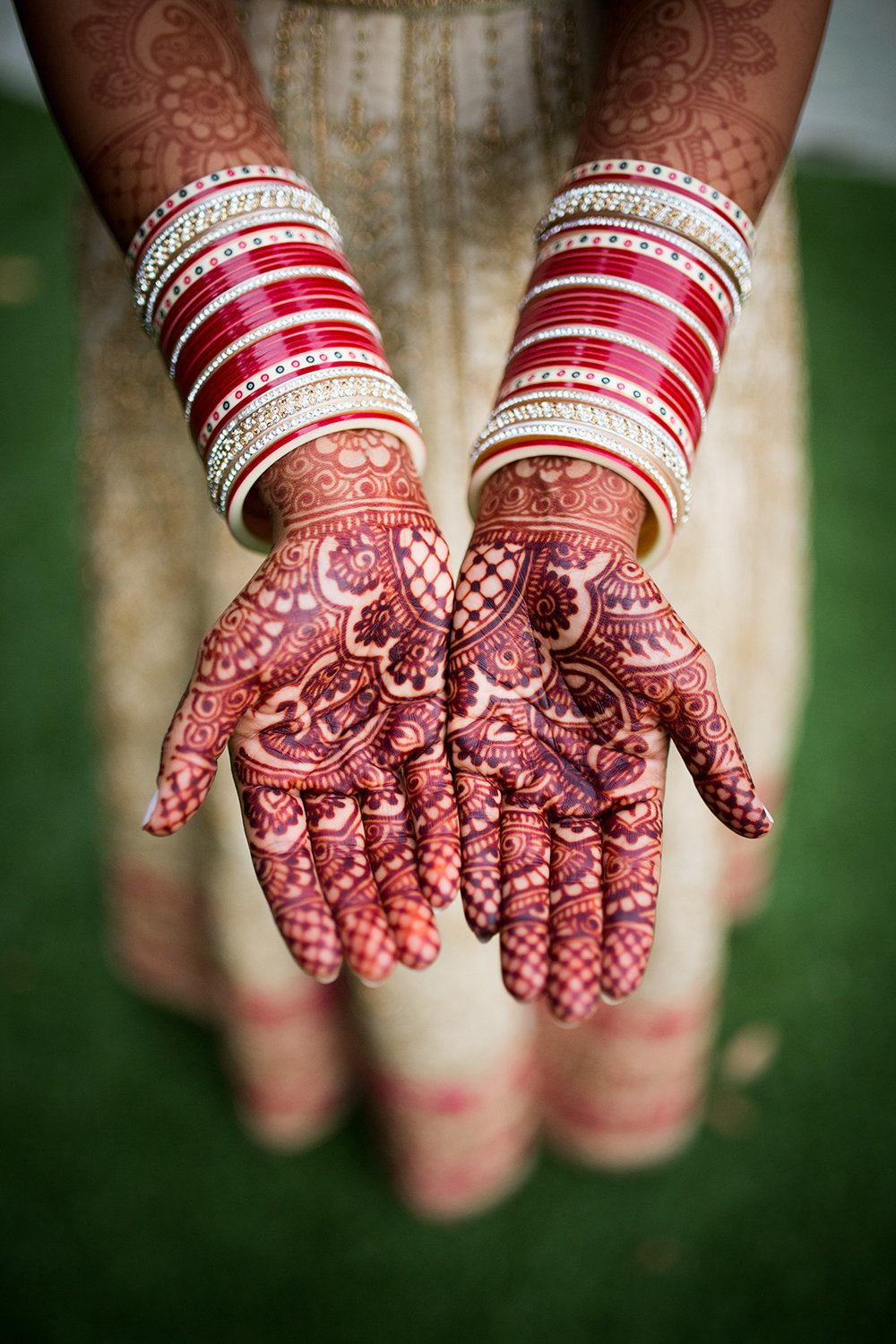 Henna Artistry and Bangles Close Up on Hindu Bride