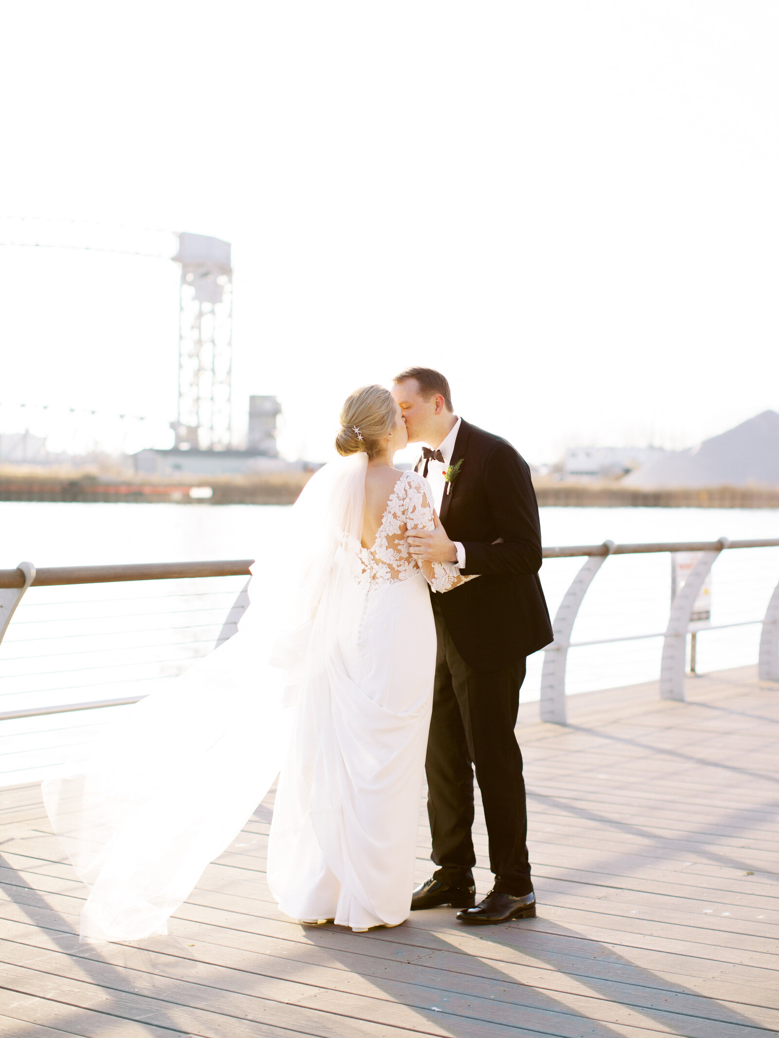 Couple kissing on cleveland pier