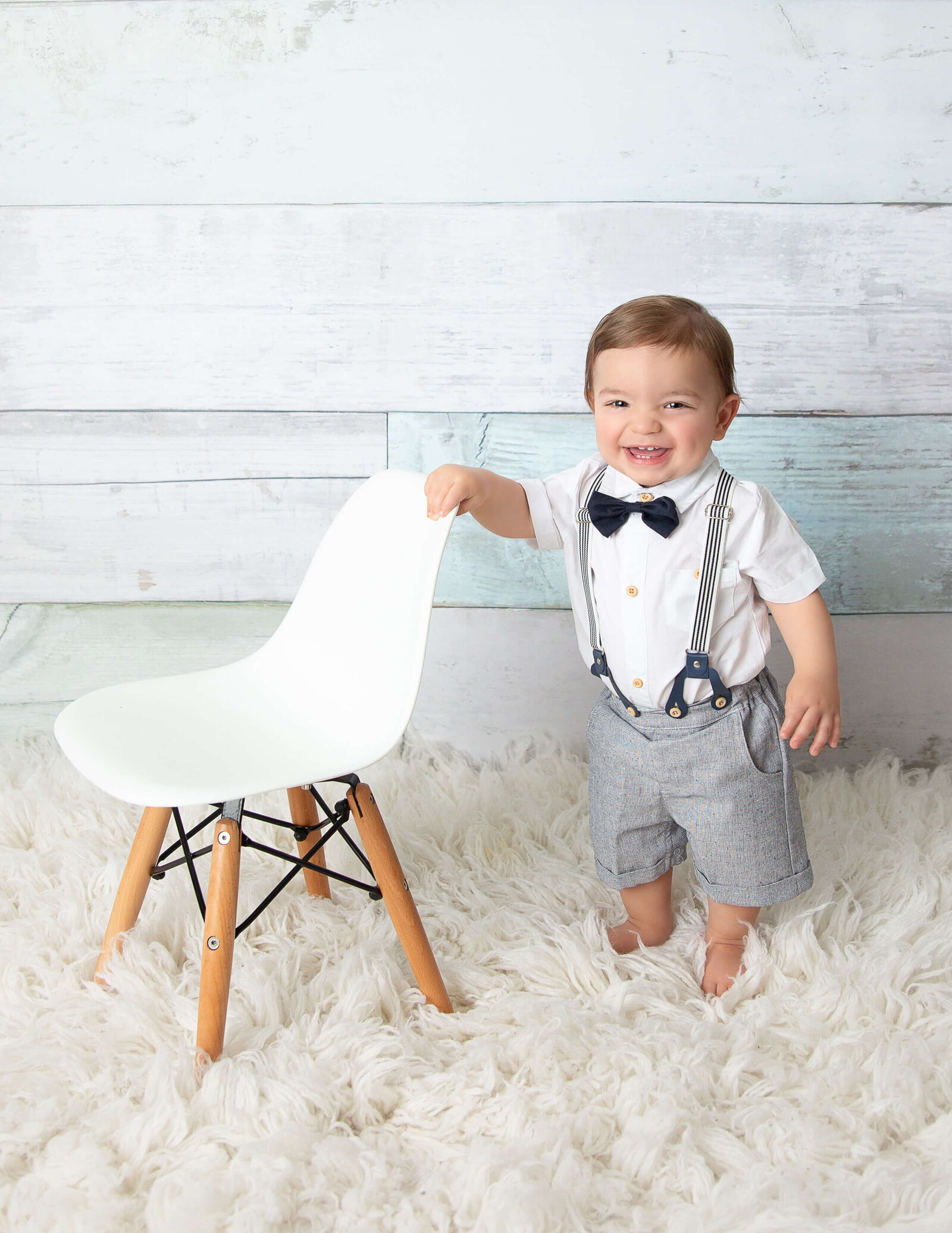 Cute boy posed in our Rochester, Ny studio.