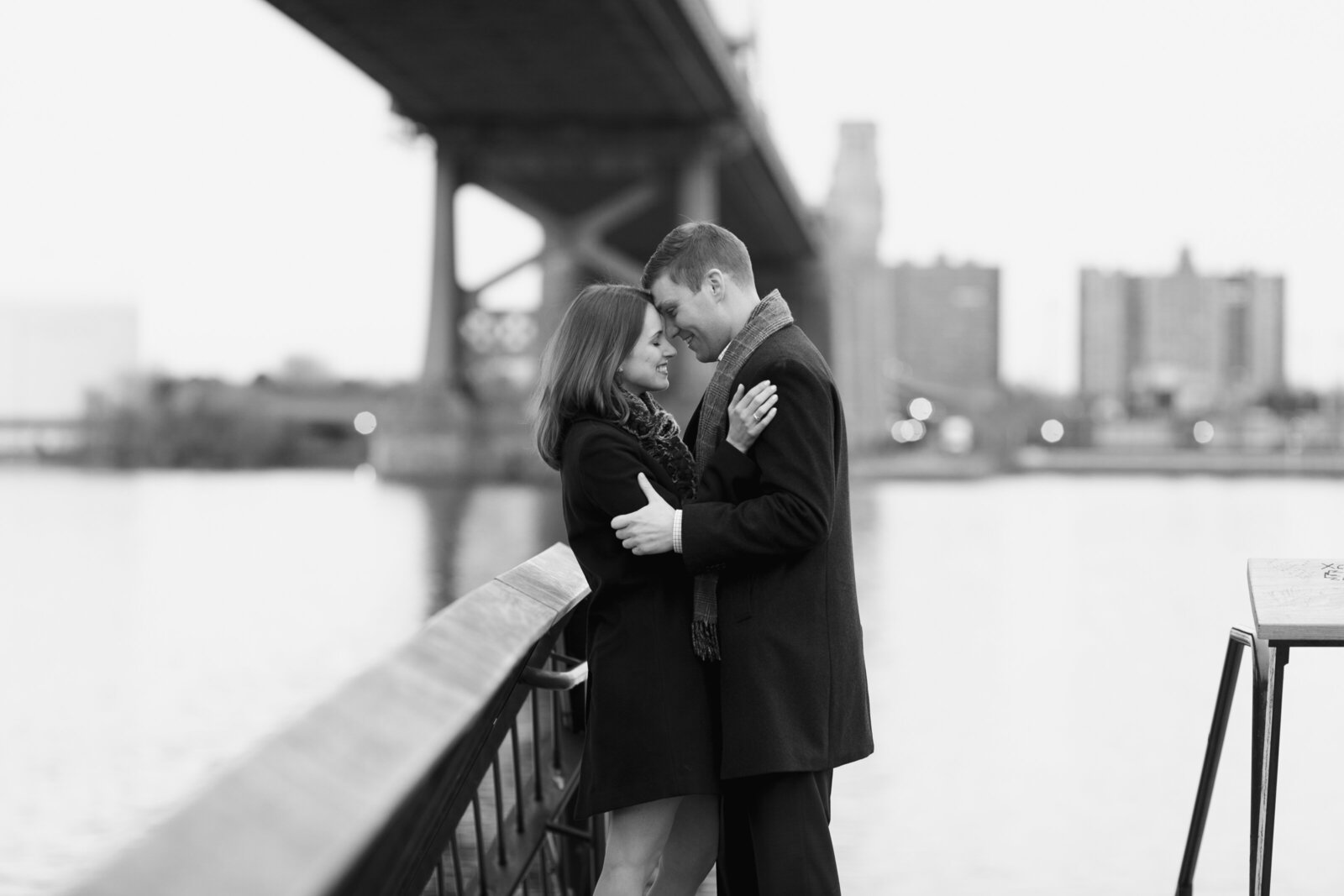 engaged couple ben franklin bridge