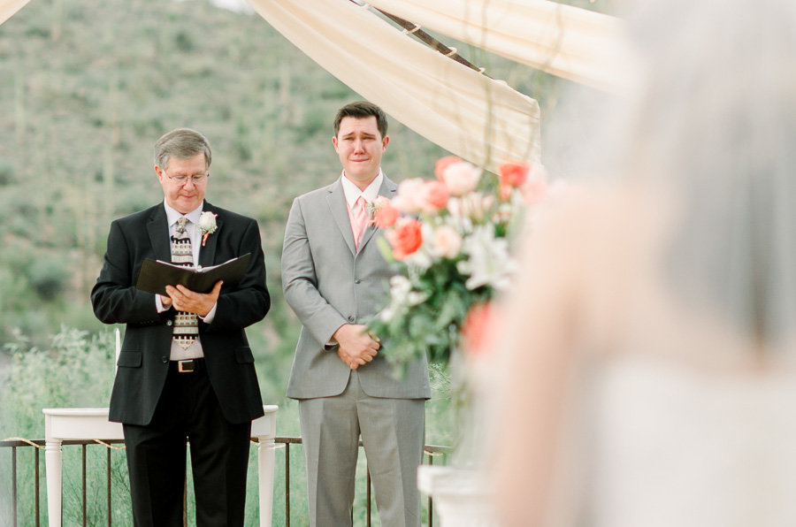 Tucson Saguaro Buttes Wedding Photo of Groom Crying as Bride Comes Down the Aisle | Tucson Wedding Photographer | West End Photography