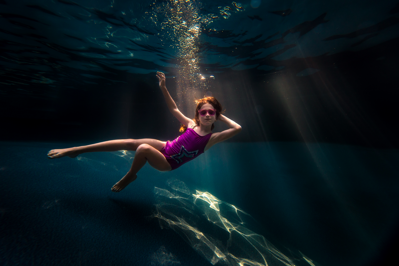 underwater photographer, columbus, ga, atlanta, pool, young girl swimming, sunrays, ker-fox photography_3769