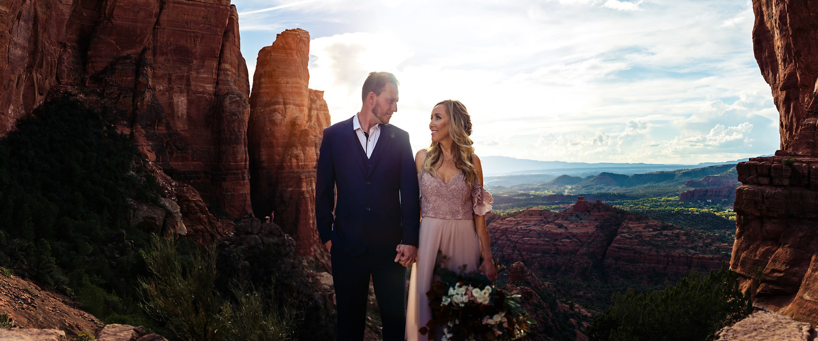 Epic landscape photo of an elopement couple in Sedona, Arizona on the top of Cathedral Rock