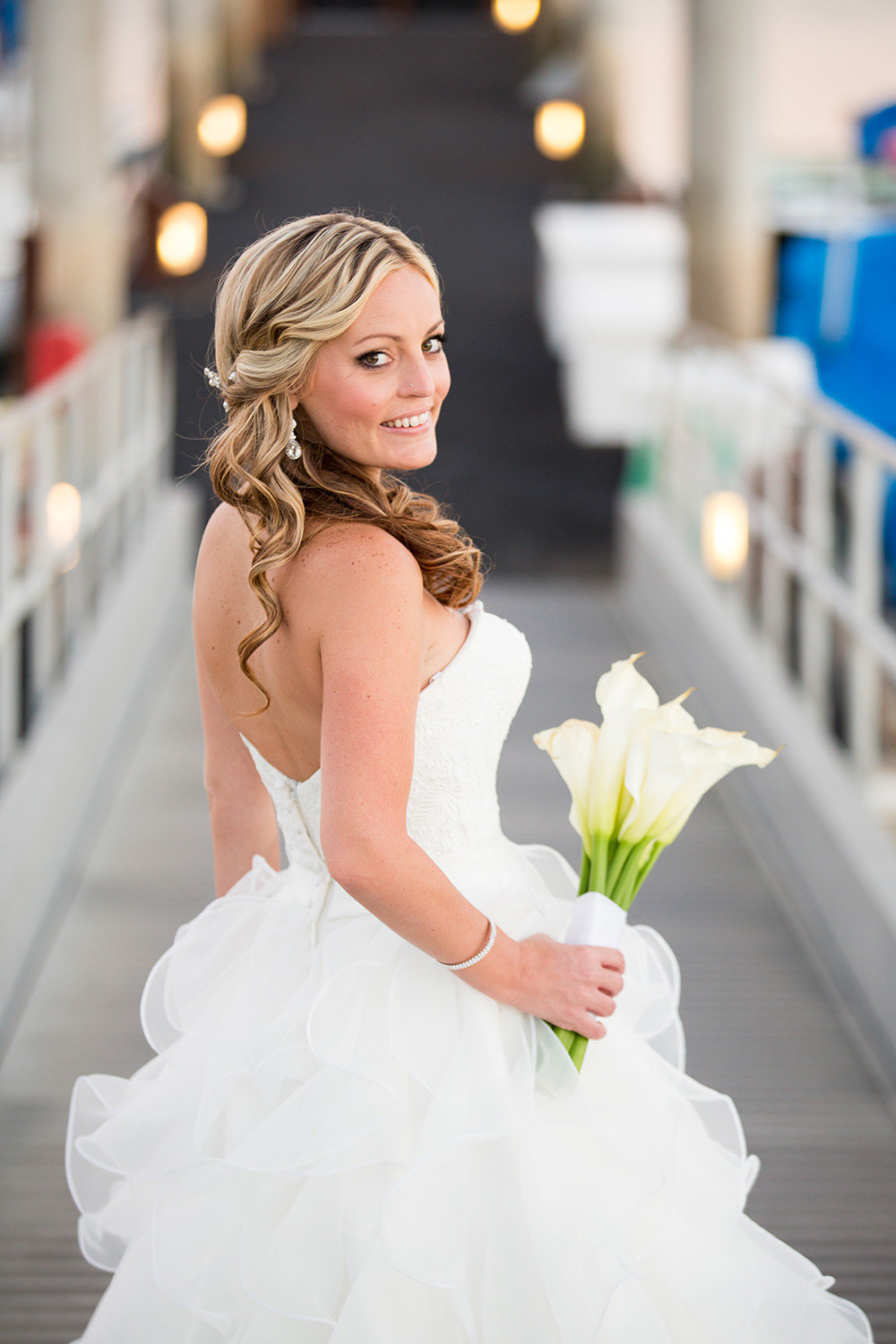 stunning bride on dock at catamaran