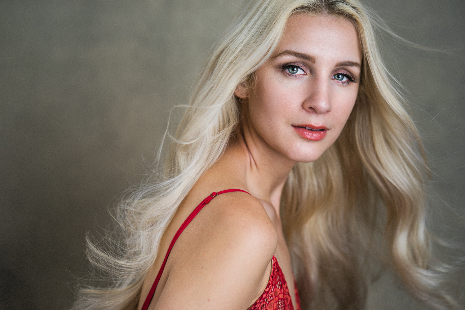 Portrait of a beautiful blonde woman in a red dress