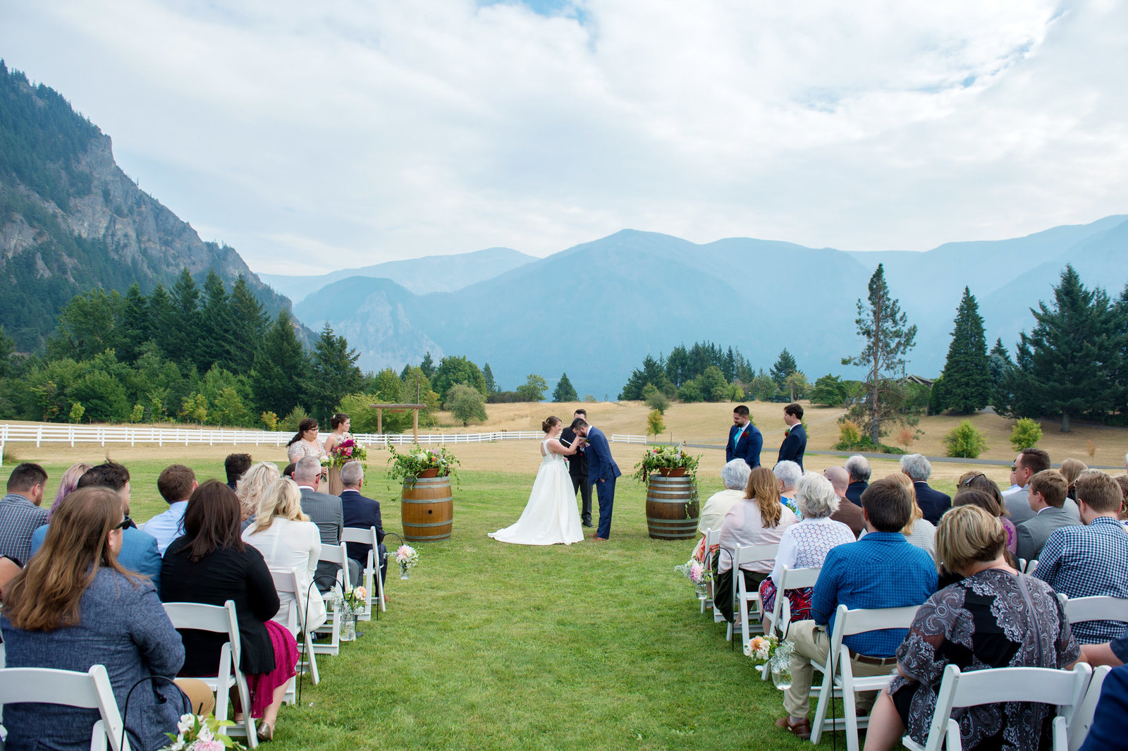 groom kisses brides hand during ceremony at wind mountain ranch