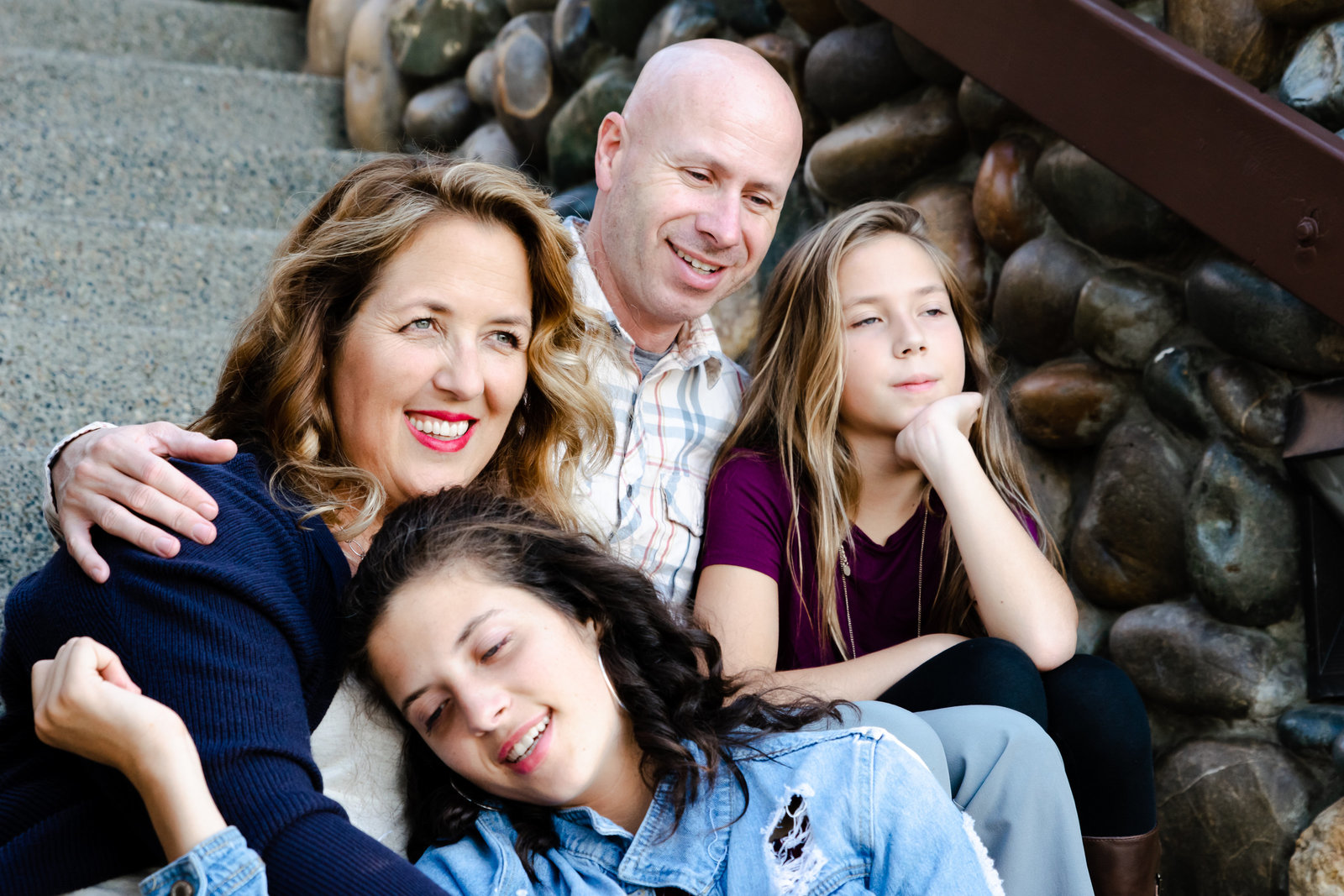 family portrait in Folsom Ca; sitting on stairs with arms around each other