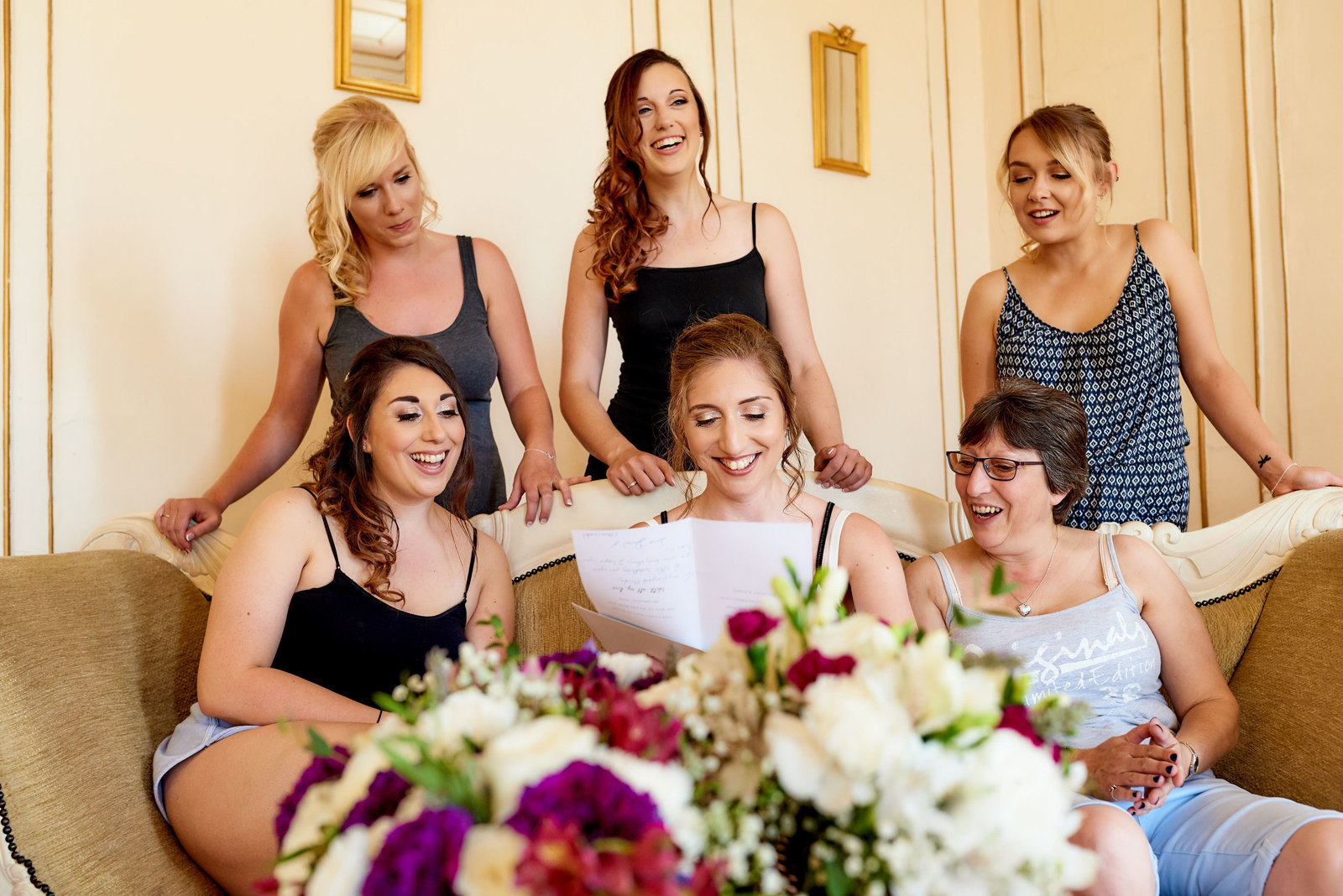 Bride and her bridesmaids at gosfield hall wedding venue in essex