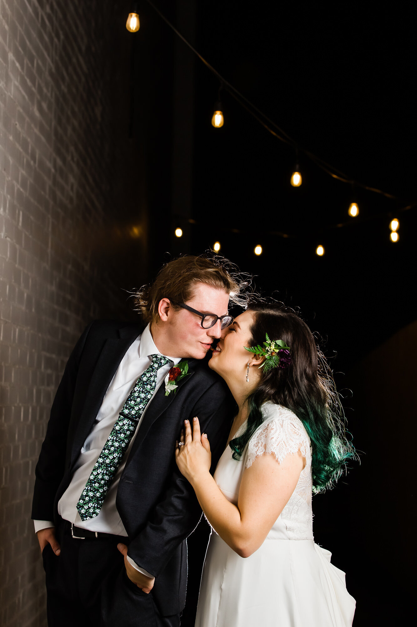 Bride and groom kissing at the wedding reception at Wild Carrot in Saint Louis