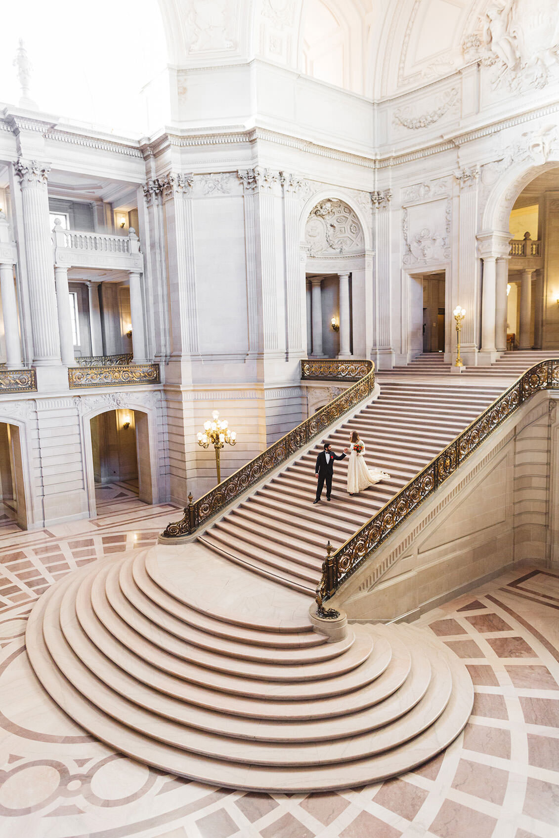 epic wide photo of the grand staircase at san francisco city hall wedding