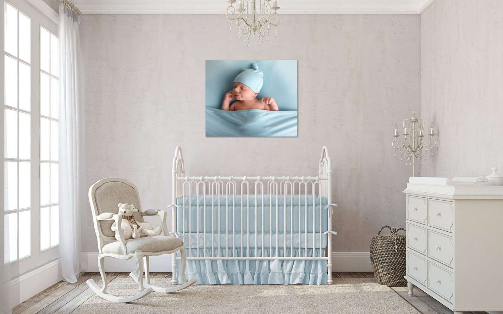 Image of a nursery with a portrait of a newborn baby boy on the wall
