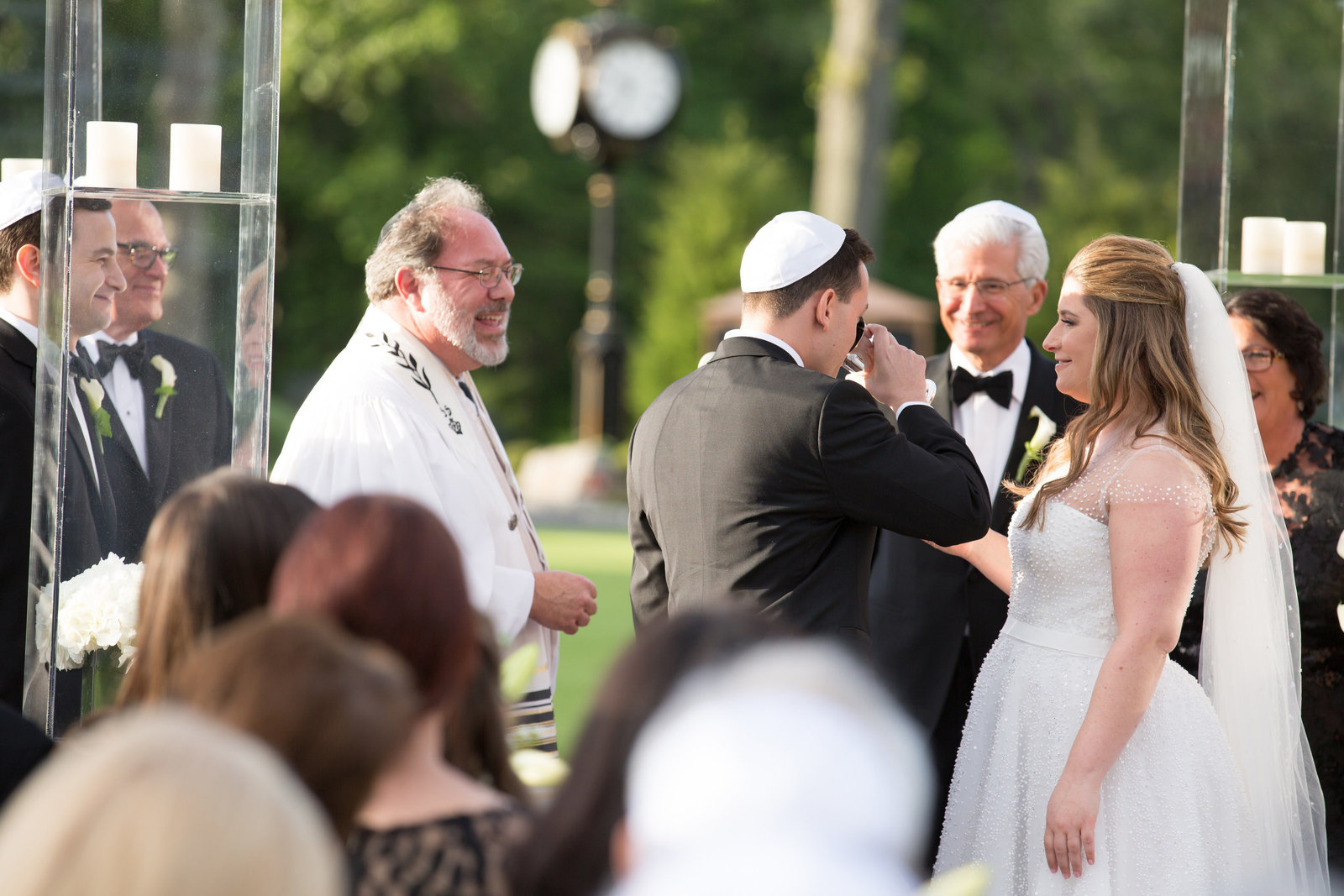 drinking from the cup of wine during a Jewish ceremony