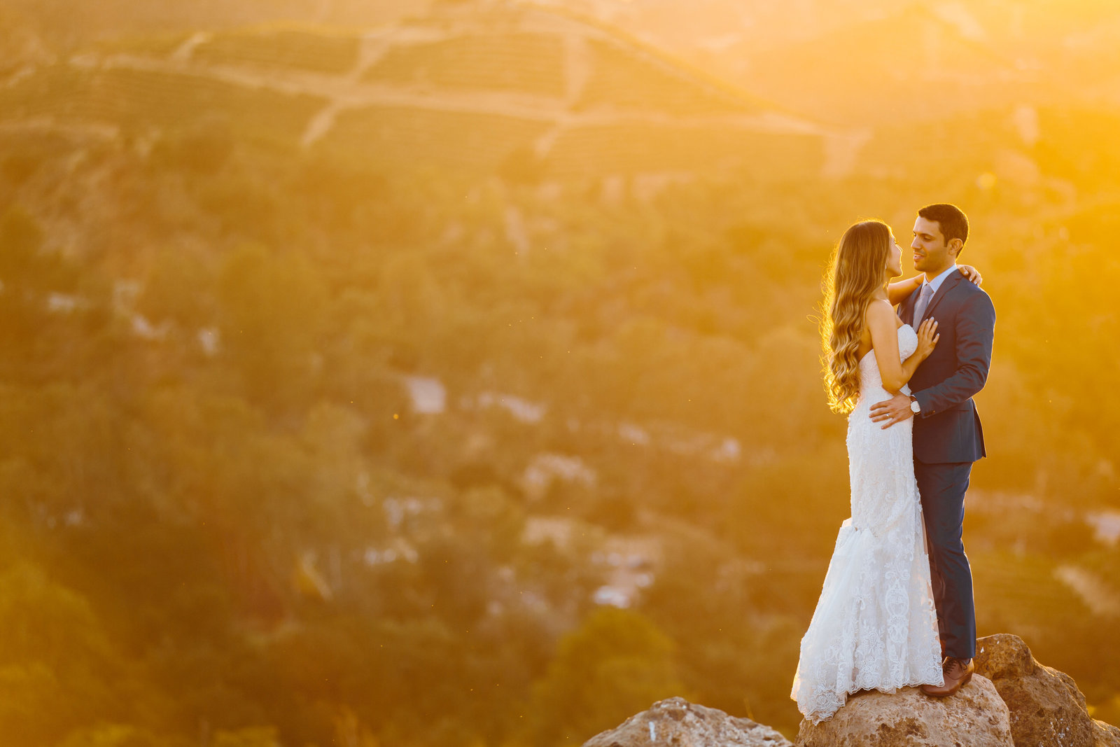 Wedding Couple on a hilltop at sunset in Malibu California