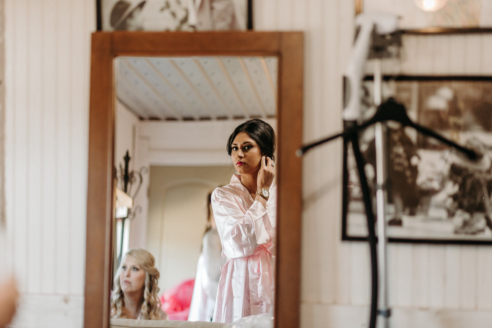 J.Michelle Photography photographs bridesmaid getting ready at vintage oaks farm wedding in Athens, Ga