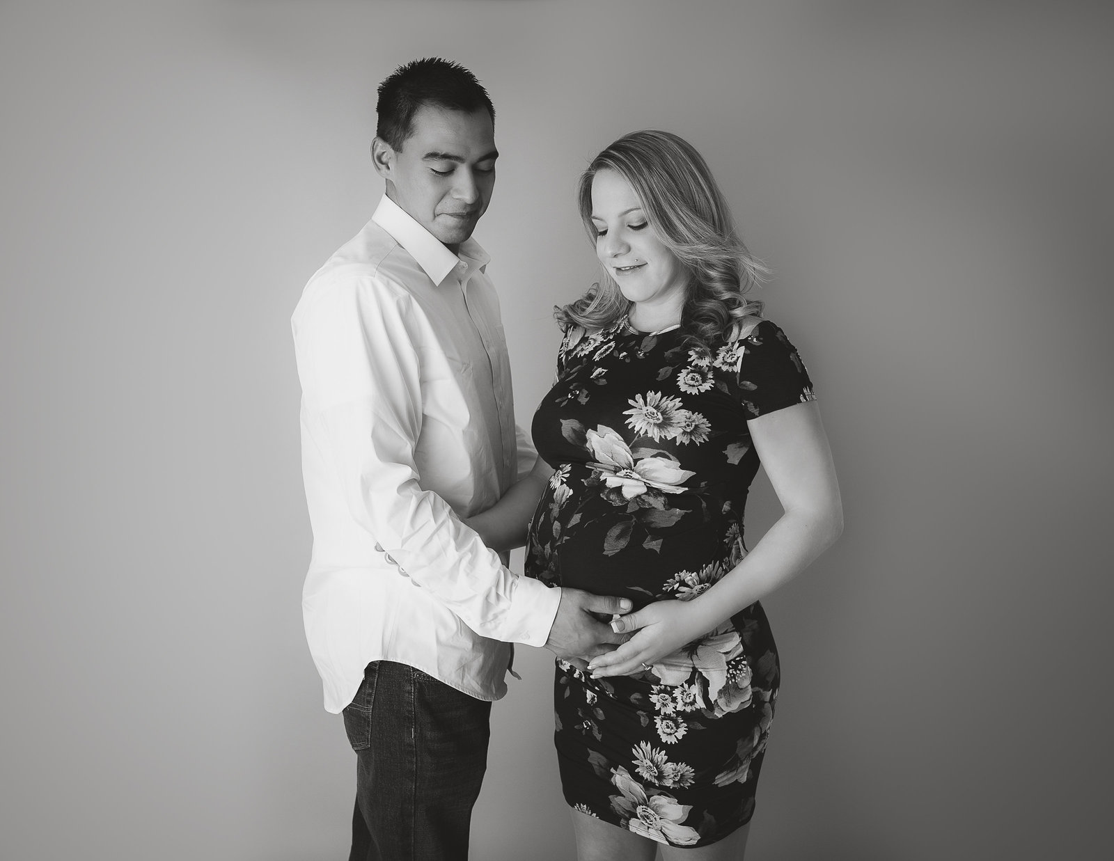 Posed maternity couple in our Rochester NY studio.