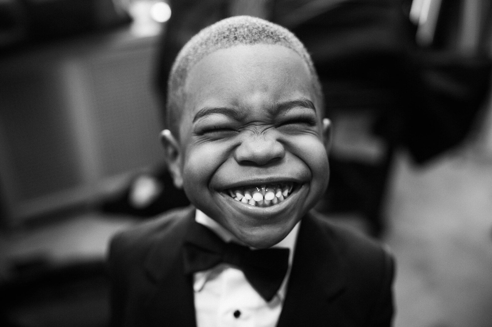 ring bearer smiles wide for camera at deleon event space