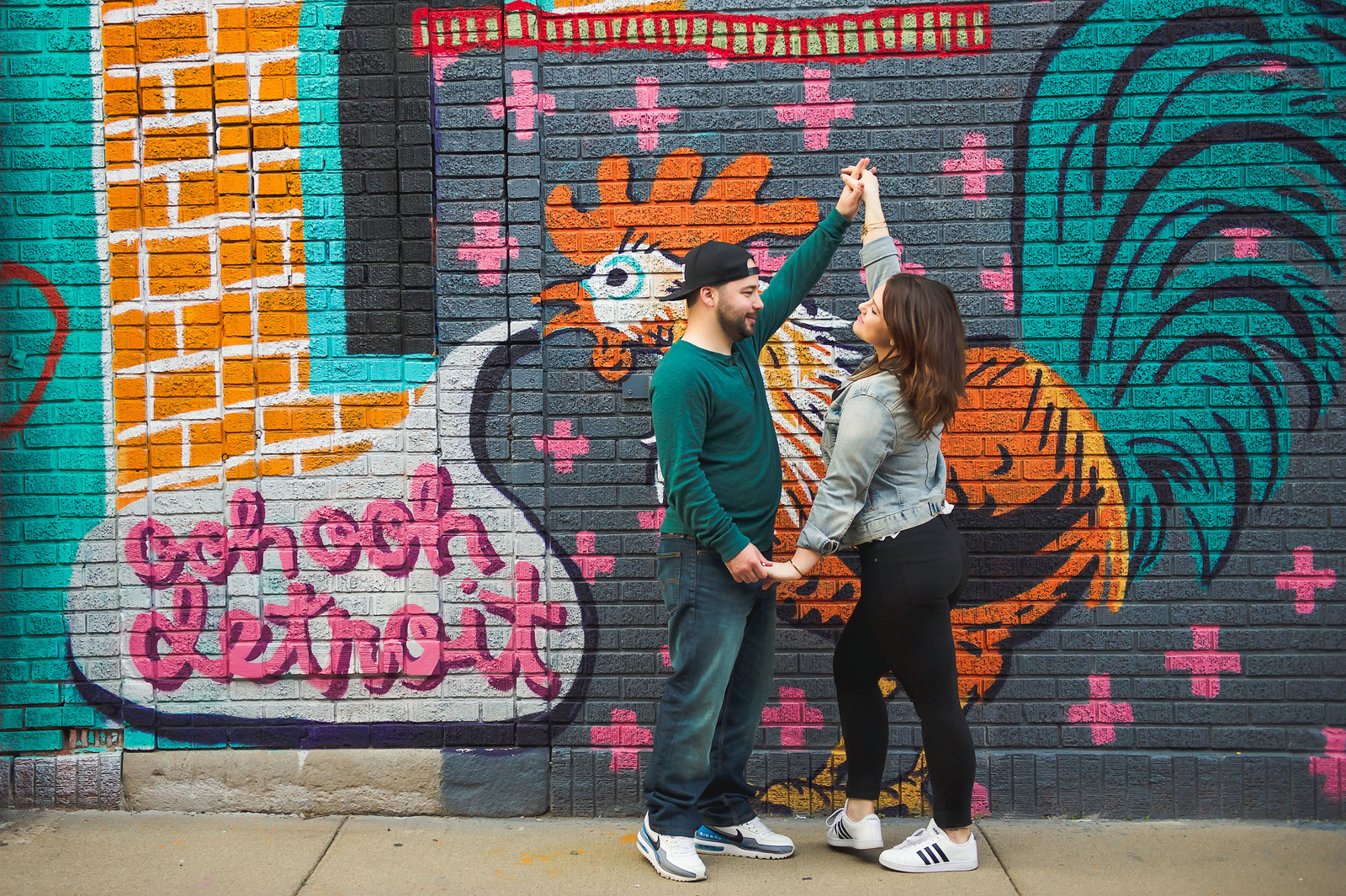 Detroit engagement photo of a bride and groom dancing in Eastern Market