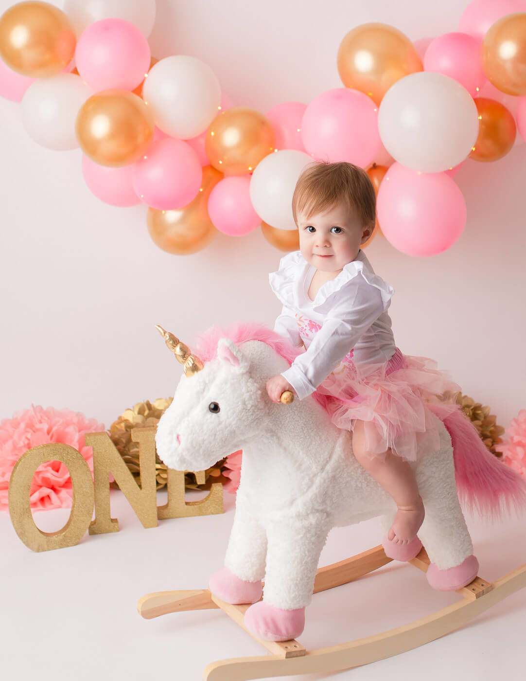 Sweet girl riding a unicorn in our studio in Rochester, NY.