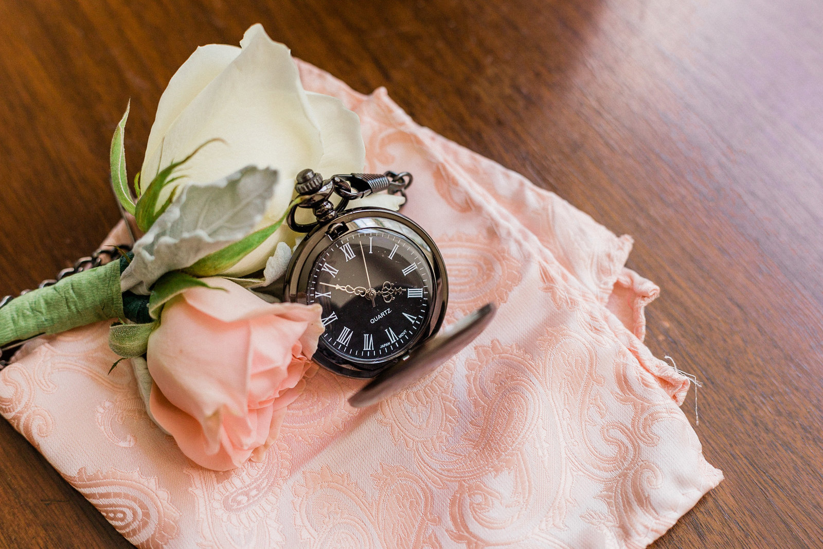 Pink and white rose boutonniere , pocket watch and pink pocket square