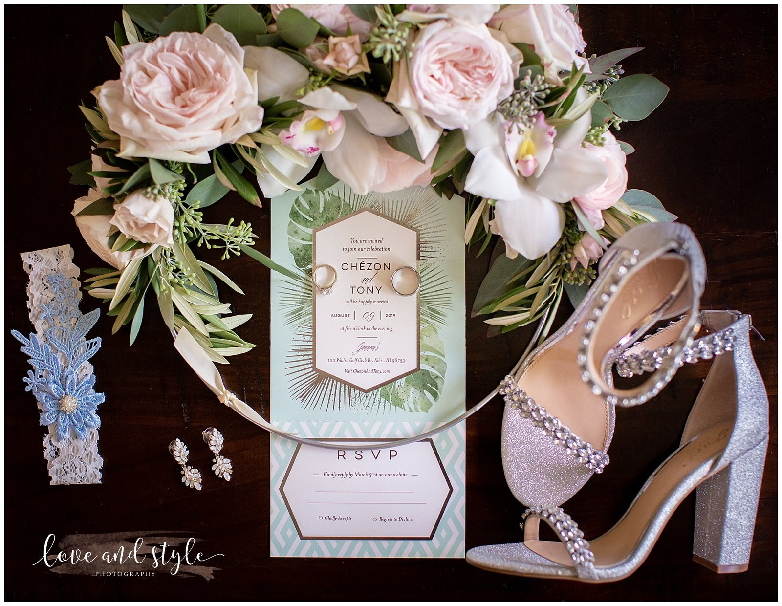 Detail shot of wedding invitation with shoes and jewelry