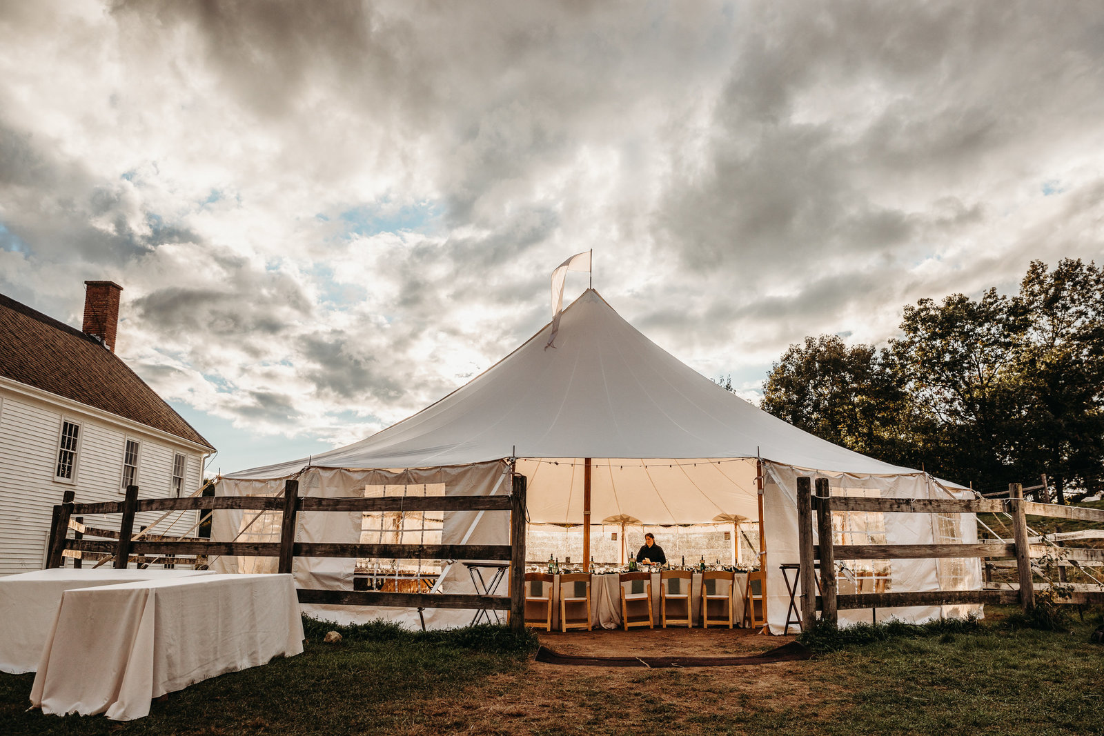 tented wedding under stormy sky in boston ma