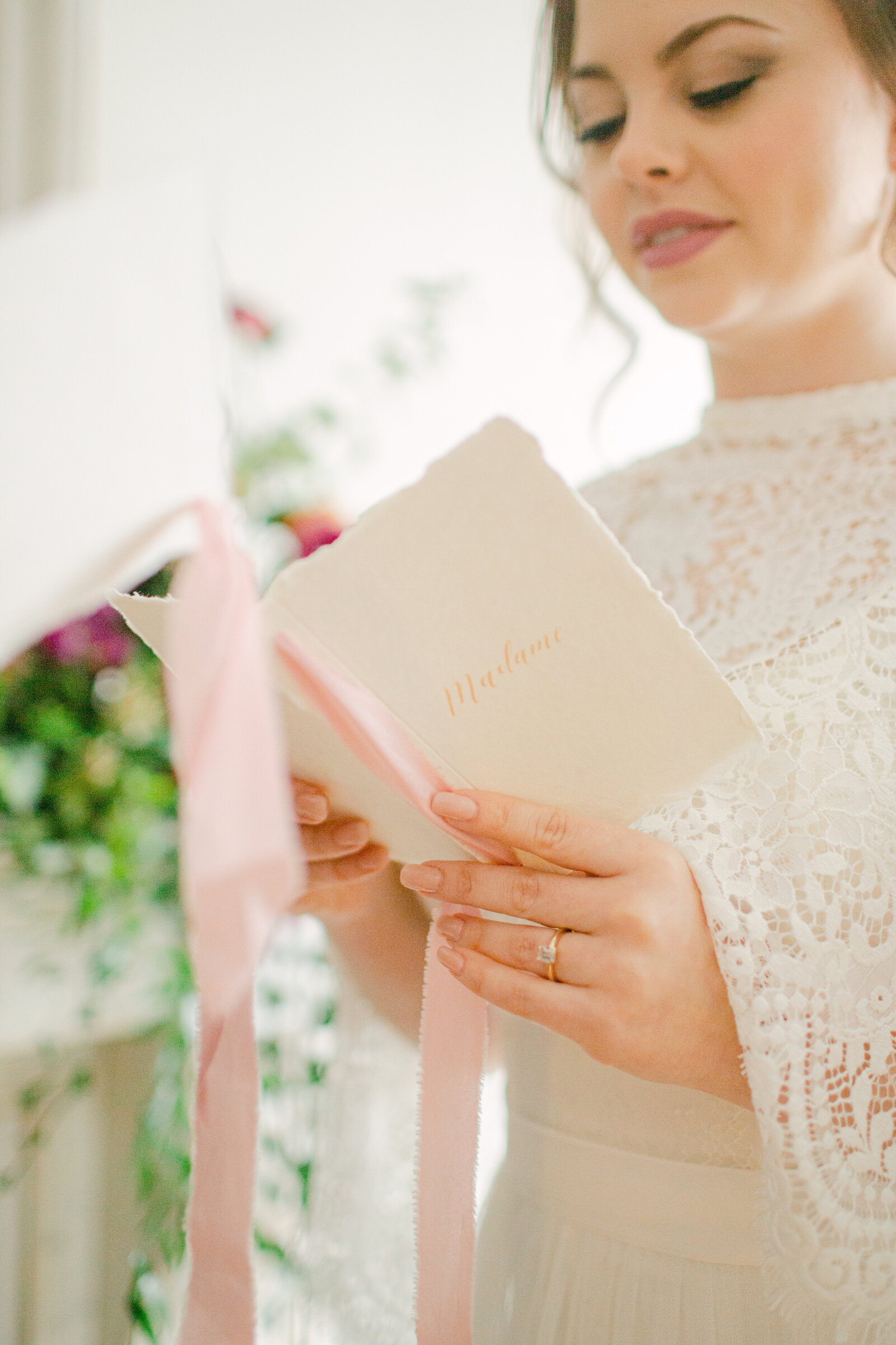 bride facing groom holding vow book and exchanging her vows