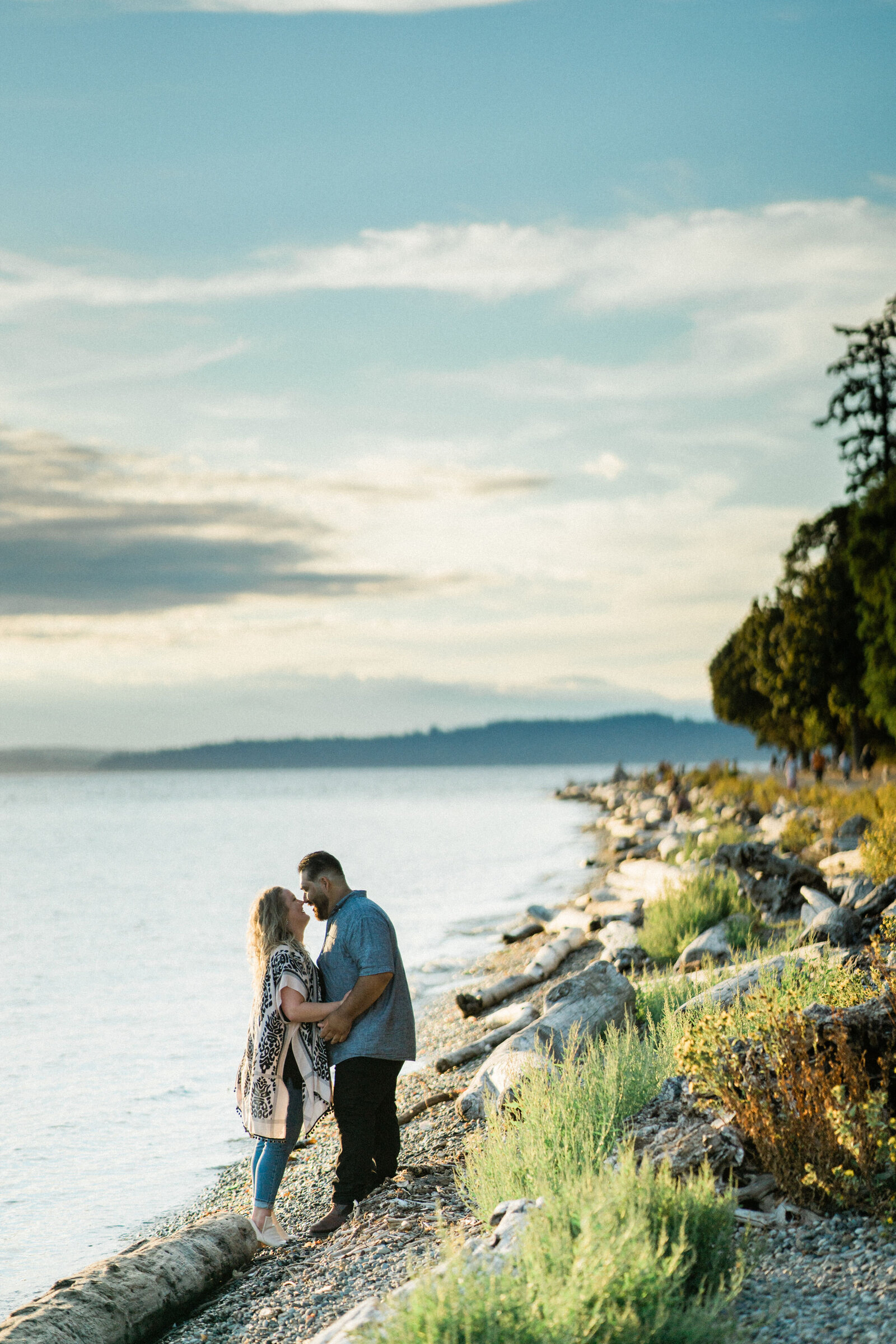 Romantic pictures at beach in Lincoln Park, a gorgeous place for engagement photos and one of the best places in Seattle for engagement pictures