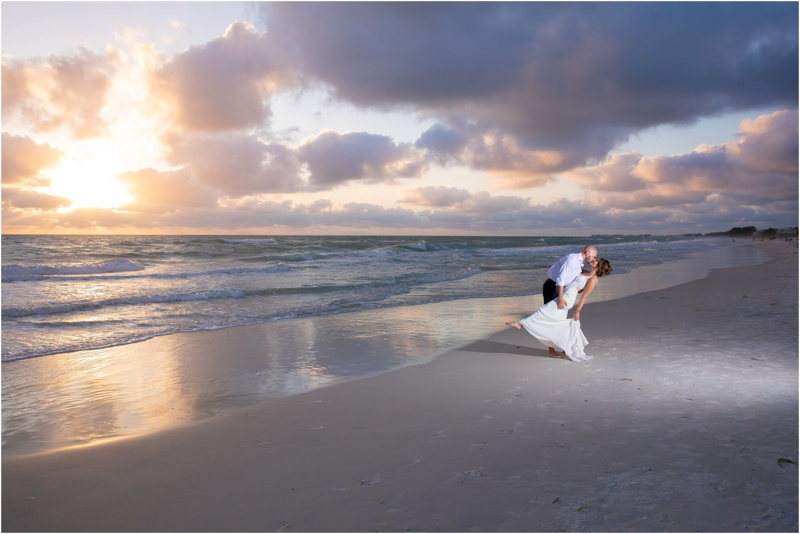Bride and Groom kissing on the beach during sunset at Anna Maria Island, Florida