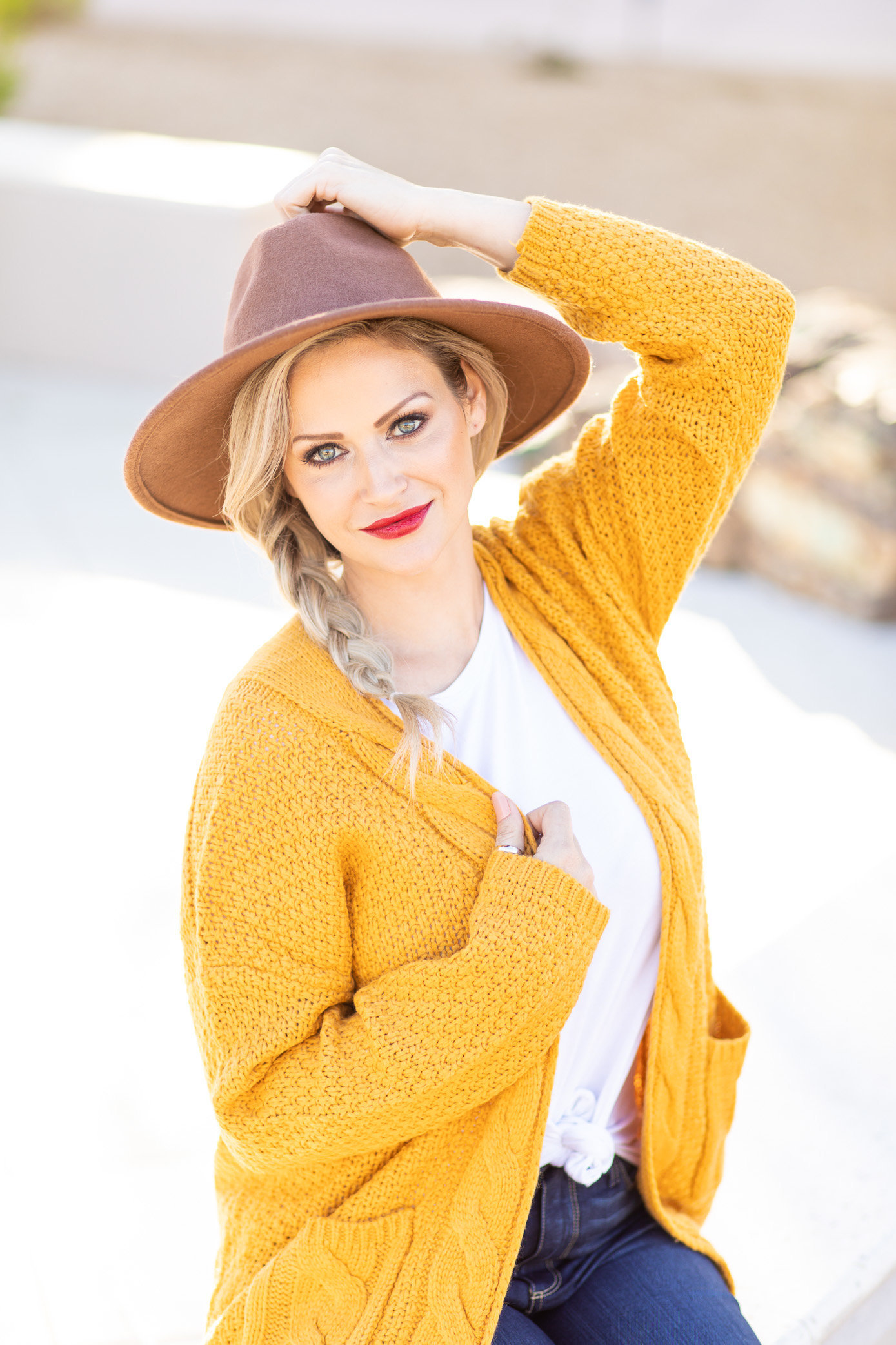 Heather Godby Wearing brown hat and mustard yellow cardigan
