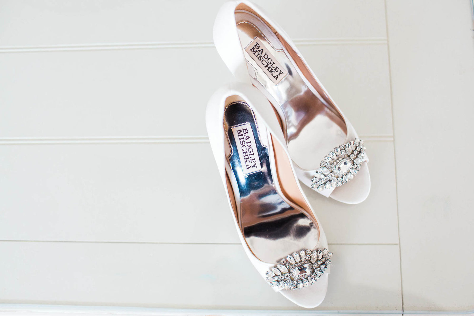 Shoes sit on white table, Isle of Palms, Charleston Wedding Photography.