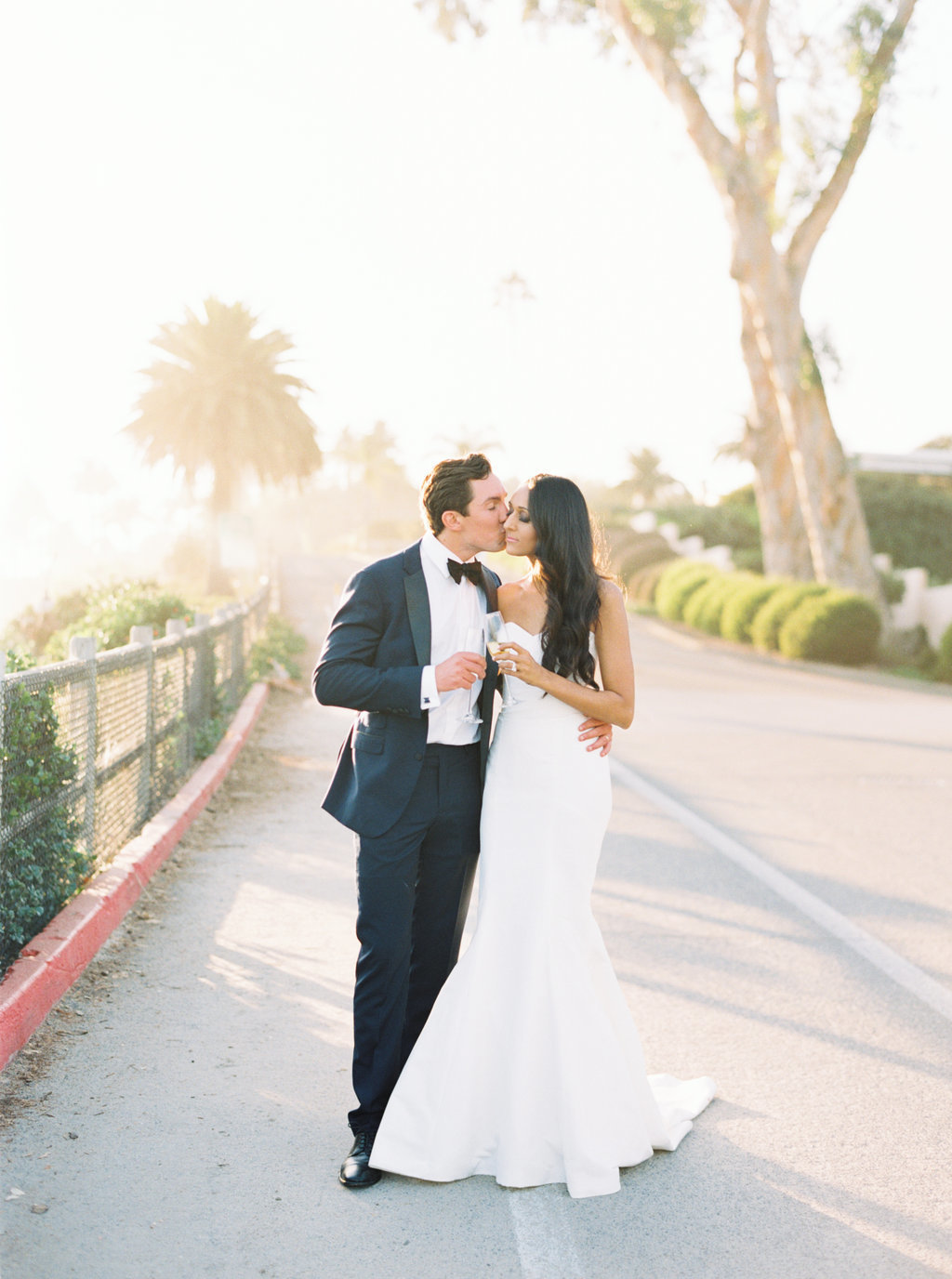 Bride and groom sunset photos on beach in Montecito
