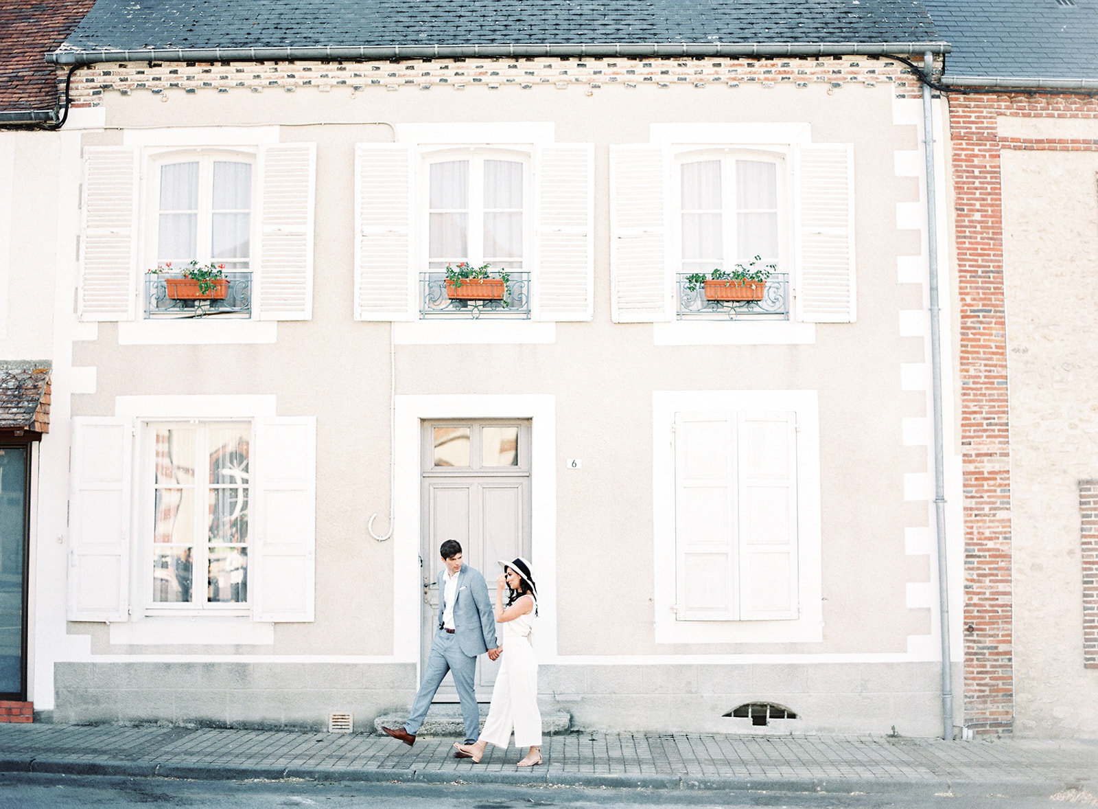 Destination engagement session in France, in front of old Normandy home. Photographed by Amy Mulder Photography