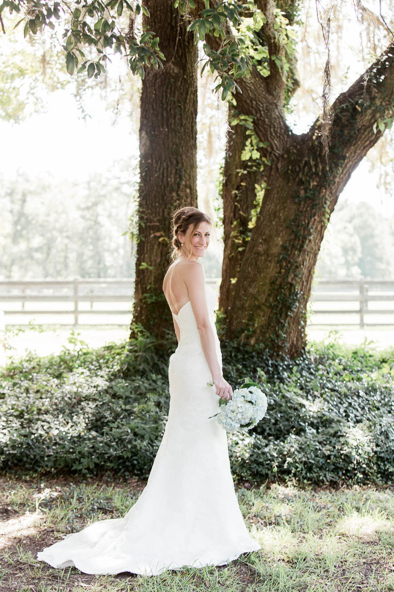 Bride poses under the oak tree, Pepper Plantation, Awendaw, South Carolina