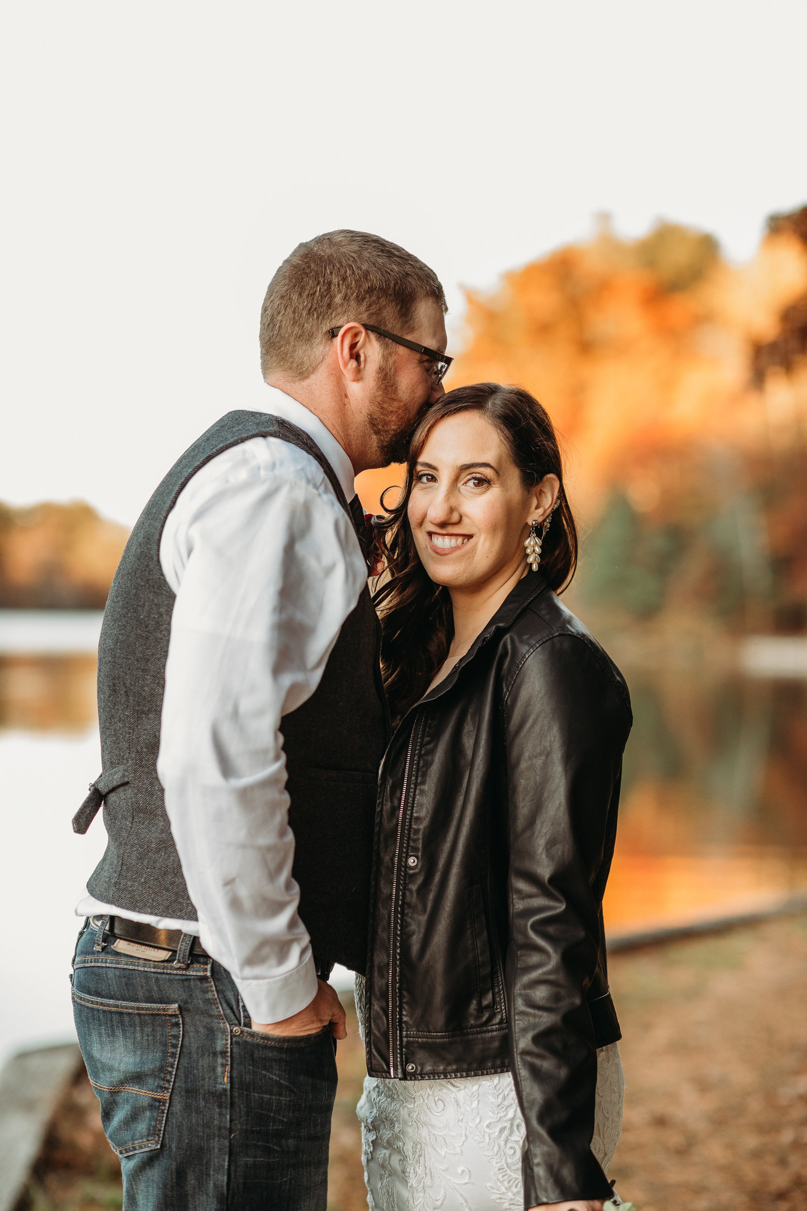 bride wearing leather jacket in november after wedding ceremony