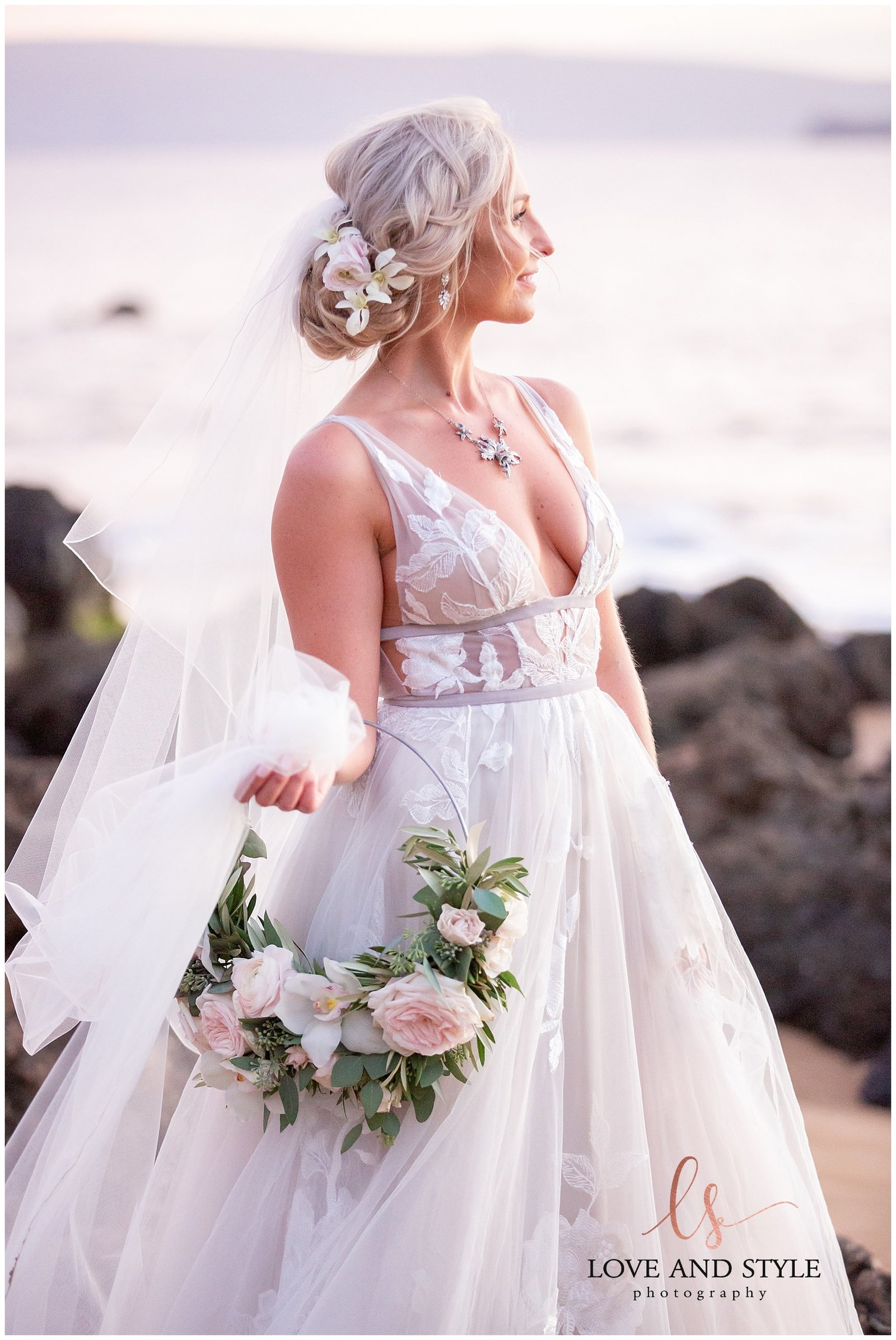 close up of the bride on the beach with gorgeous bouquet