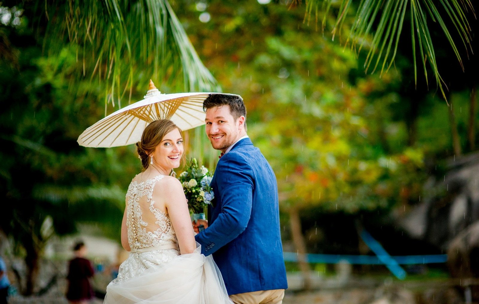Bride and Groom under parasol