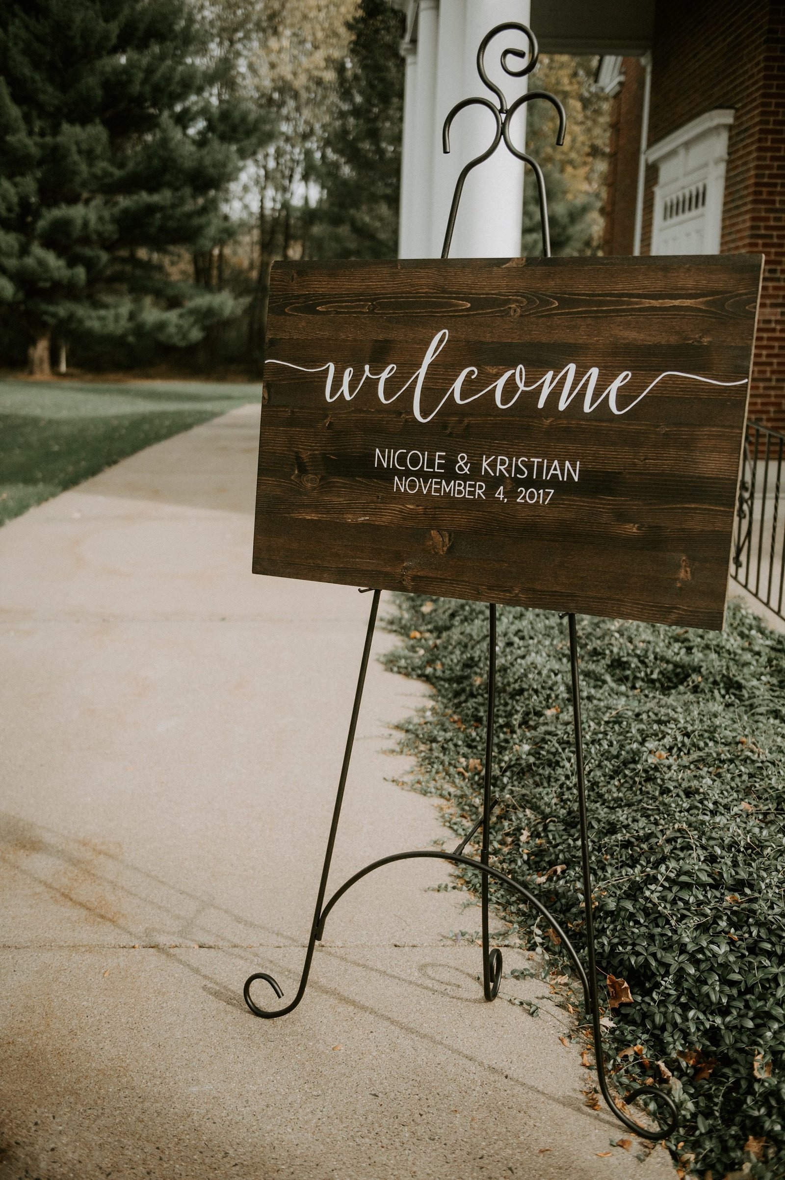 Rustic wooden ceremony welcome sign for wedding at The Webb Barn in Wethersfield, CT