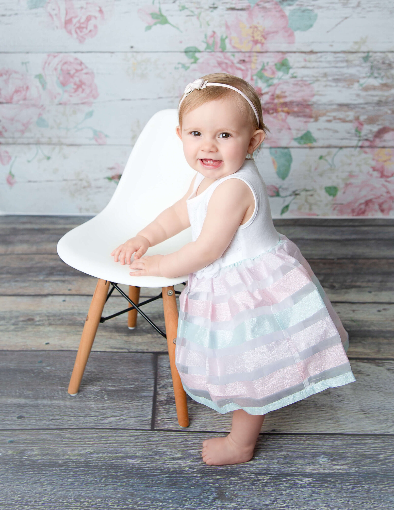 Adorable little girl posed in  our stdio located in Rochester, NY.