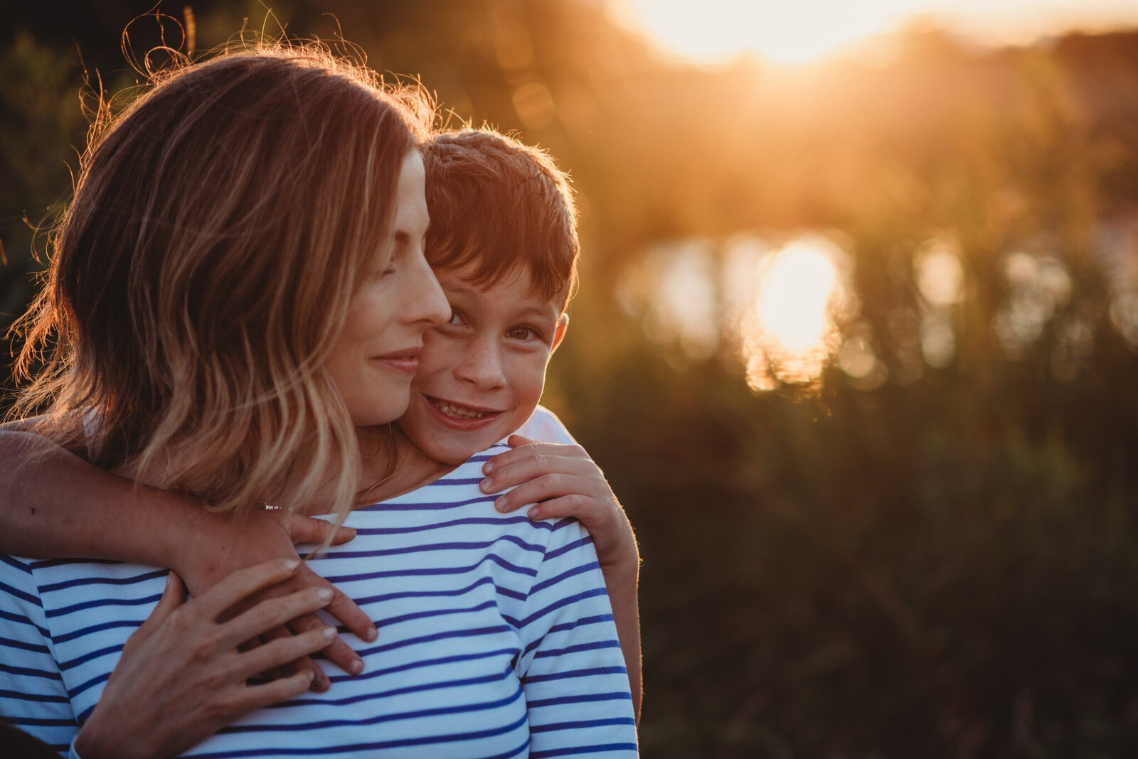 Close up of a son hugging his mother at sunset in Oshawa'