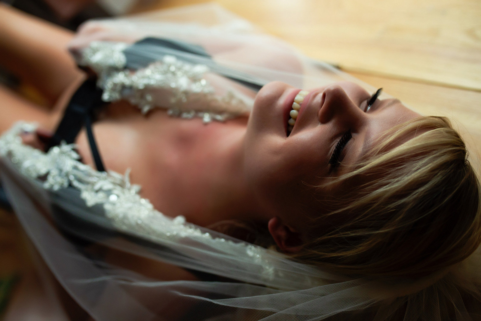 Smiling bride in a boudoir photography session in St. Louis