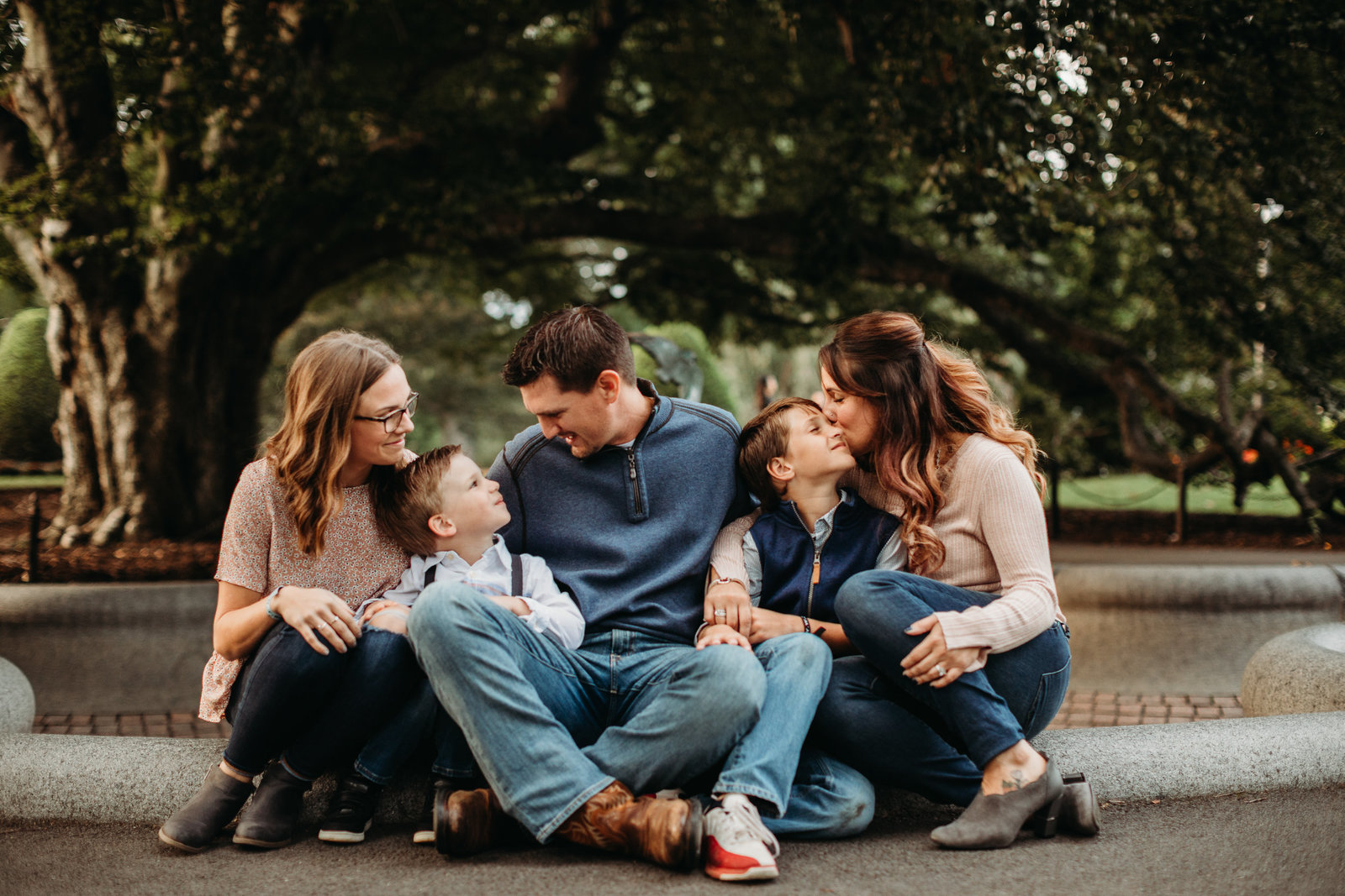 family of five snuggles close in downtown boston for photo shoot