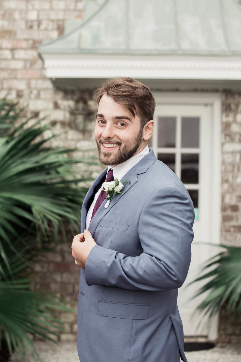 Groom poses for portrait, The Island House, Charleston, South Carolina. Kate Timbers Photography.