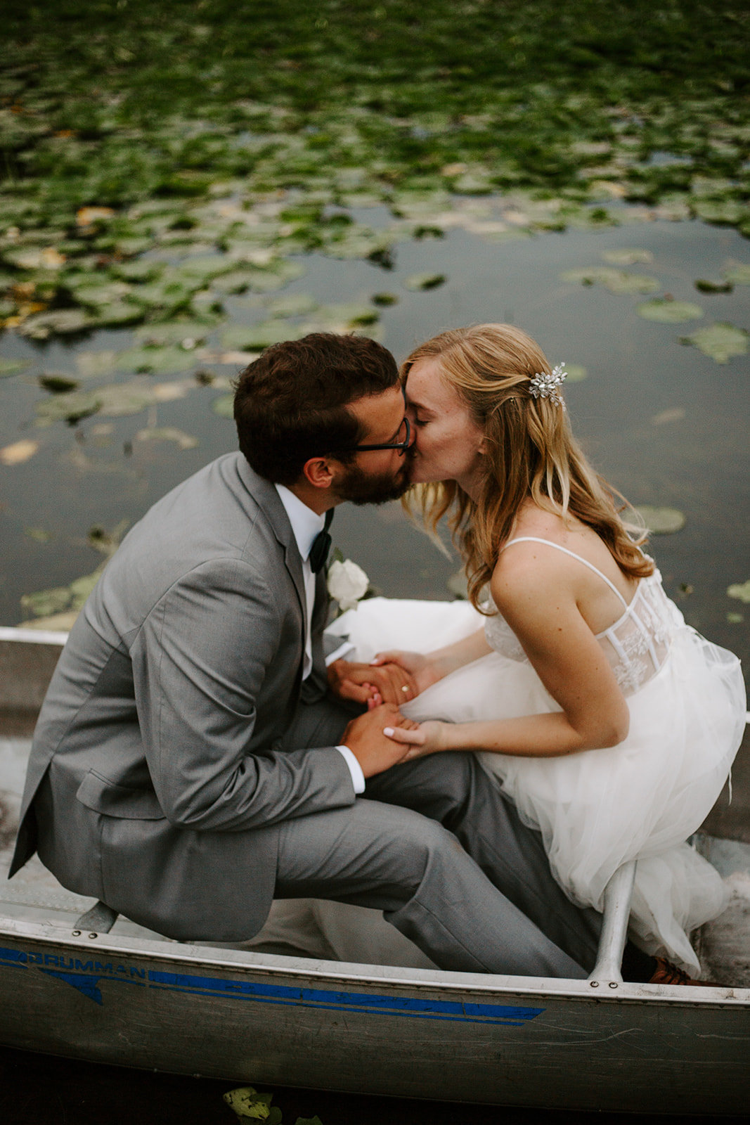 Bride and Groom kissing in a canoe during their elopement
