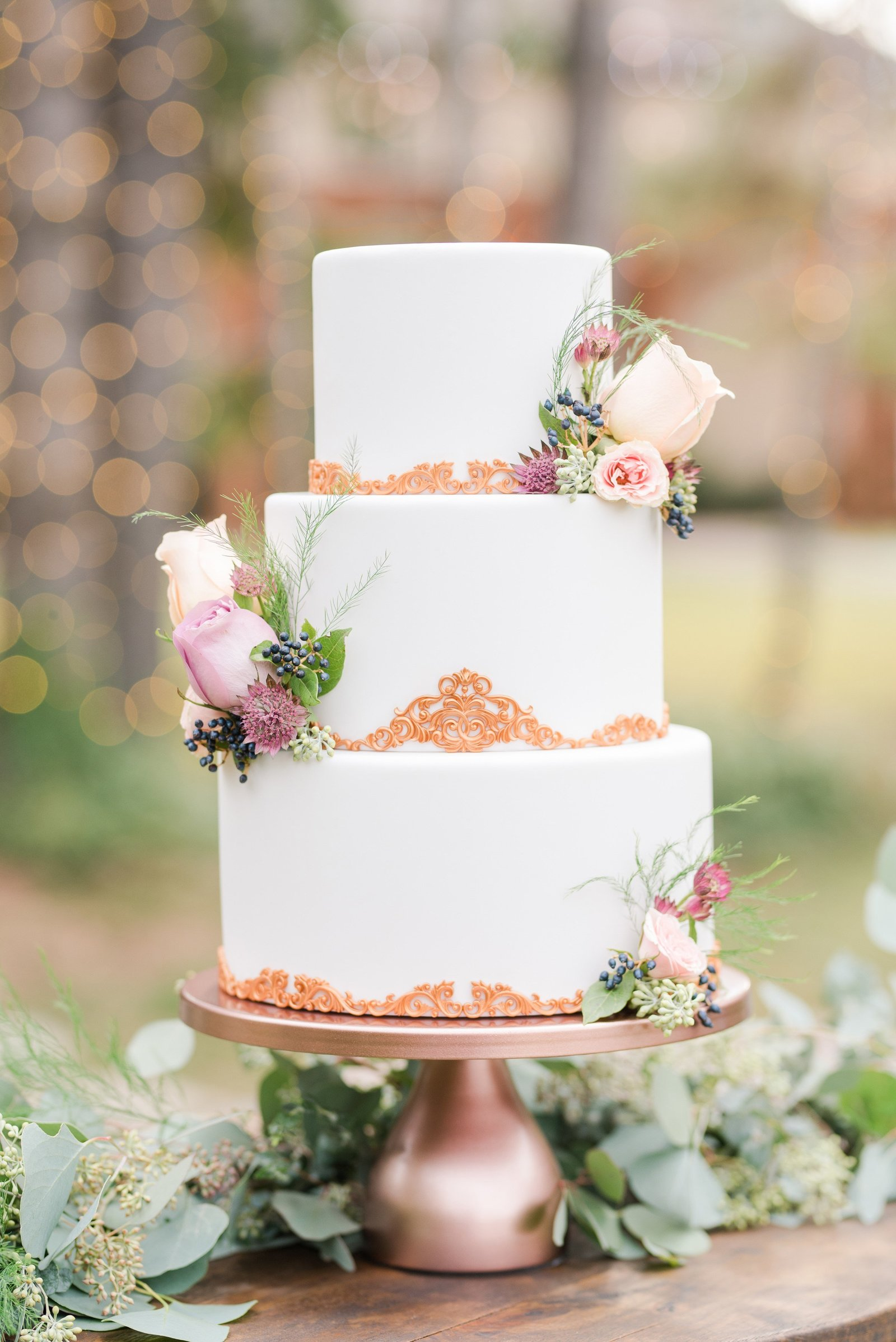 Sage green and copper and white wedding cake