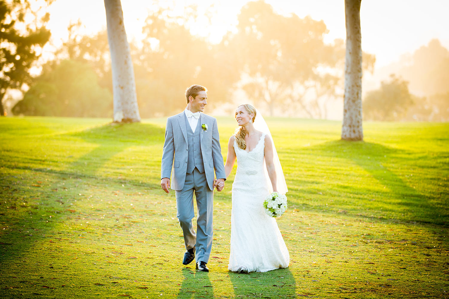 bride and groom walking golf cousre