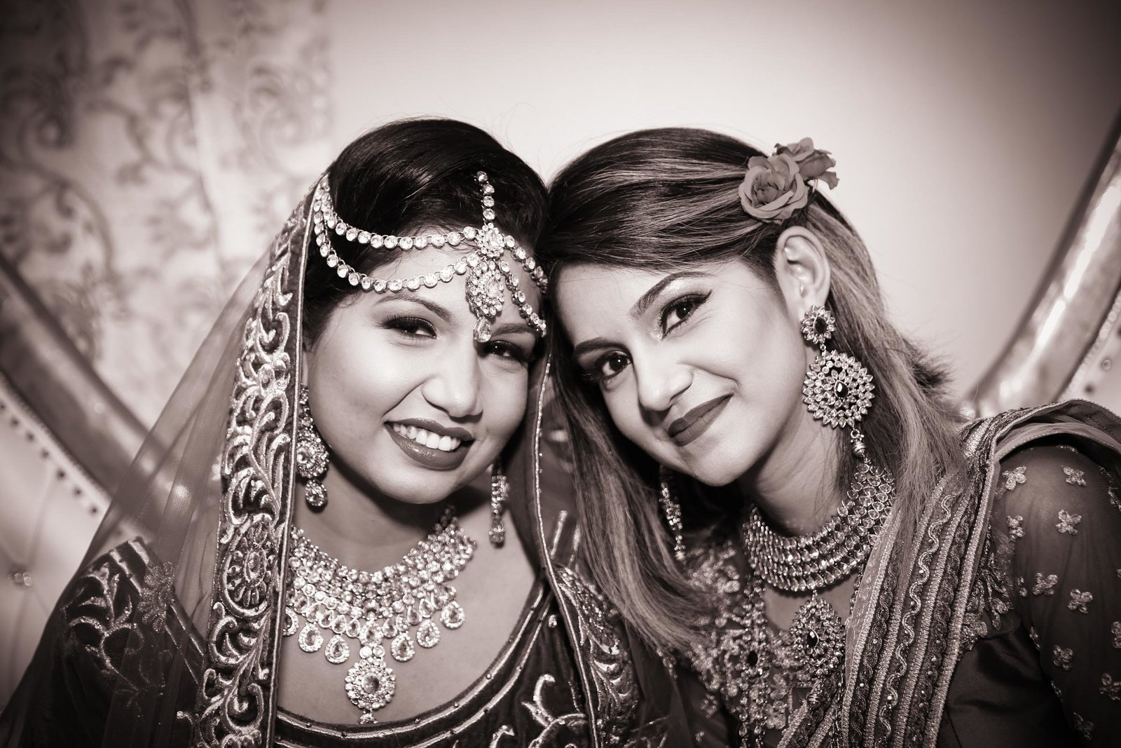 Sisters at Indian wedding in B+W. Photo by Ross Photography, Trinidad, W.I..